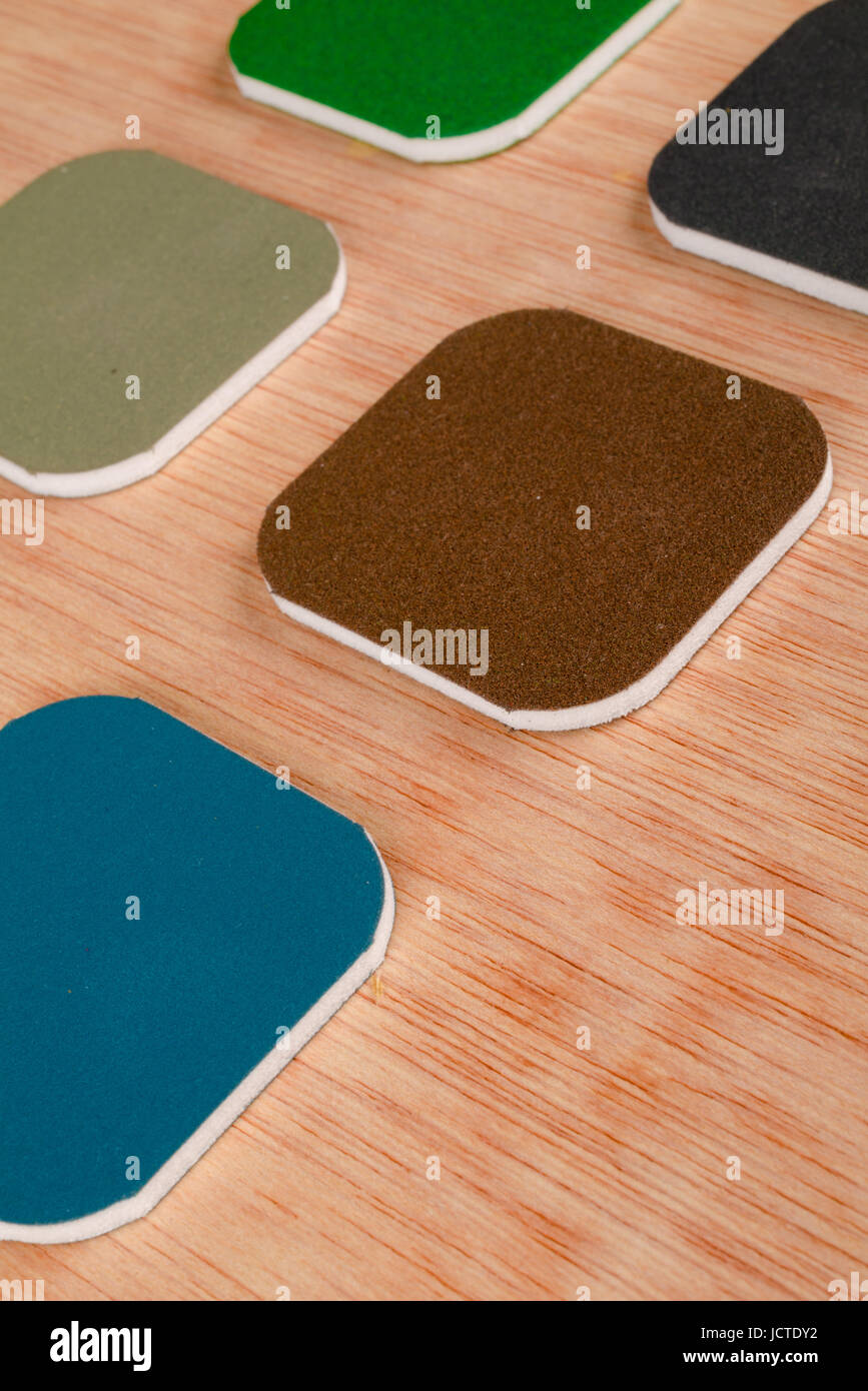 Assortment of different grades of emery paper in the shape of pads - Stock Image