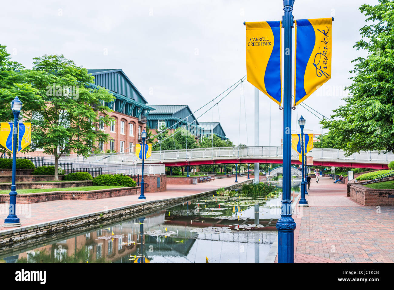 Frederick, USA - May 24, 2017: Carroll Creek in Maryland city park with canal, reflection and people walking by - Stock Image