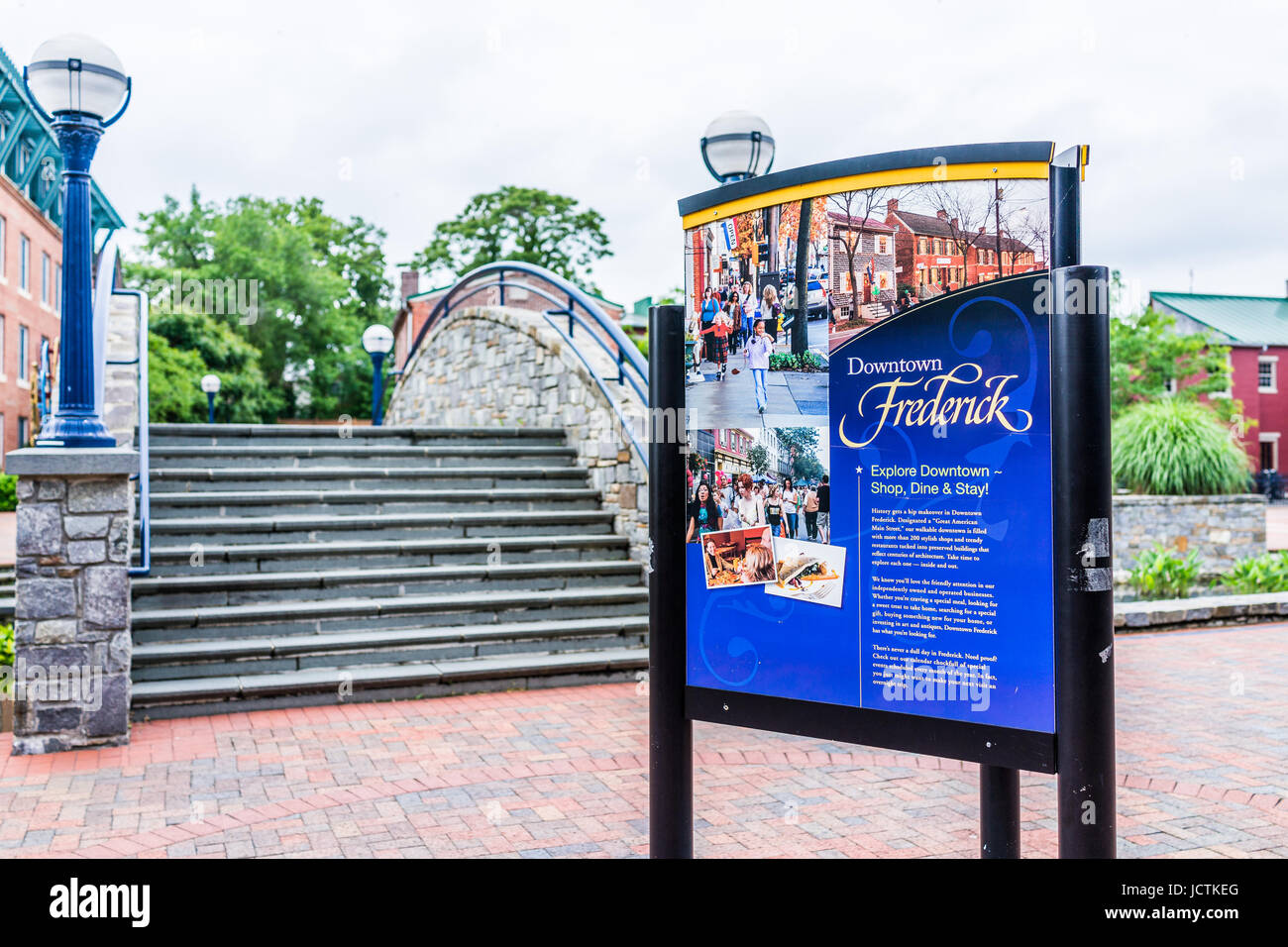 Frederick, USA - May 24, 2017: Carroll Creek in Maryland city park with sign and red brick area - Stock Image