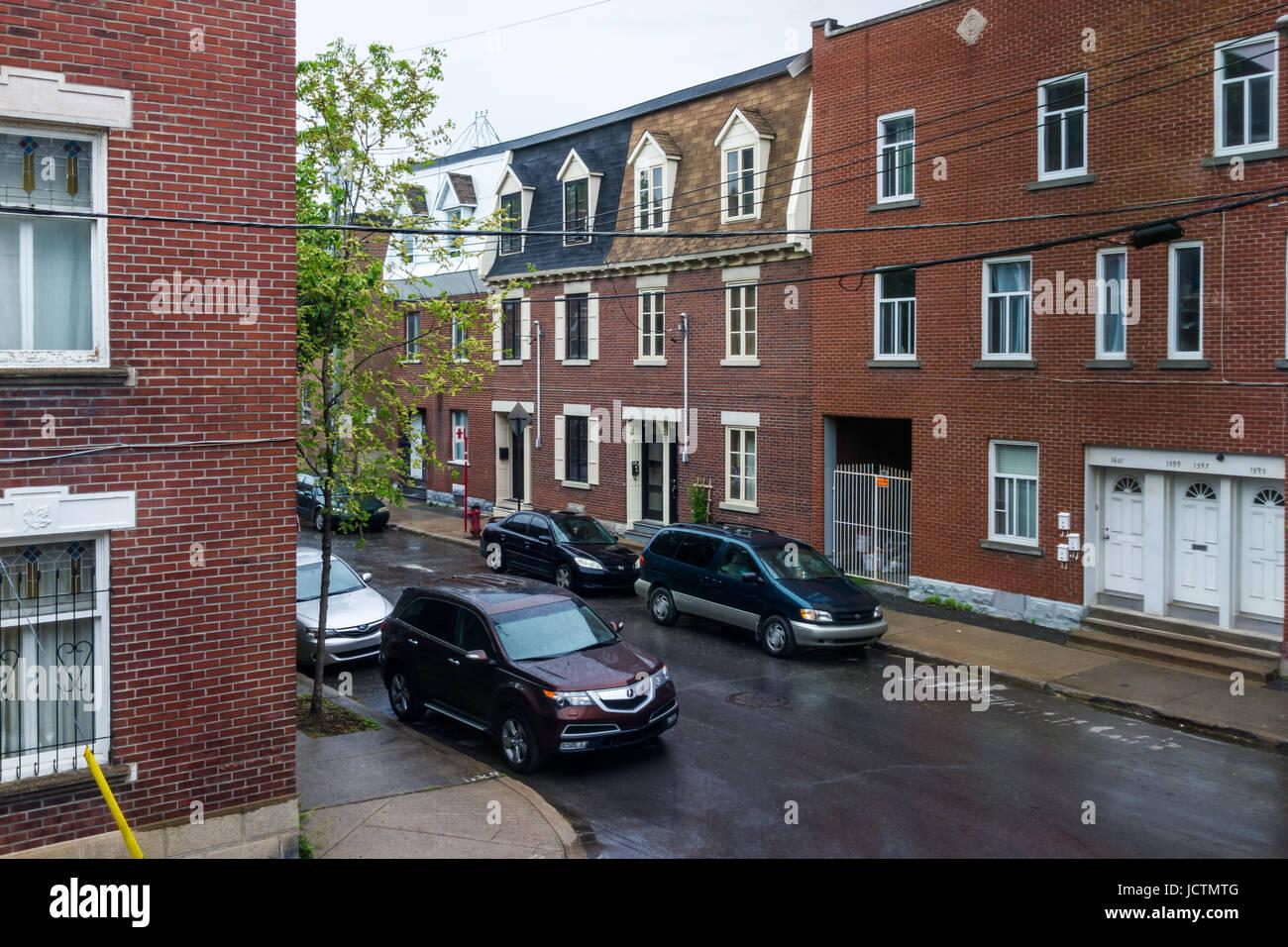 Montreal, Canada - May 25, 2017: Residential brick buildings in Quebec region in Sainte Marie neighborhood of city Stock Photo