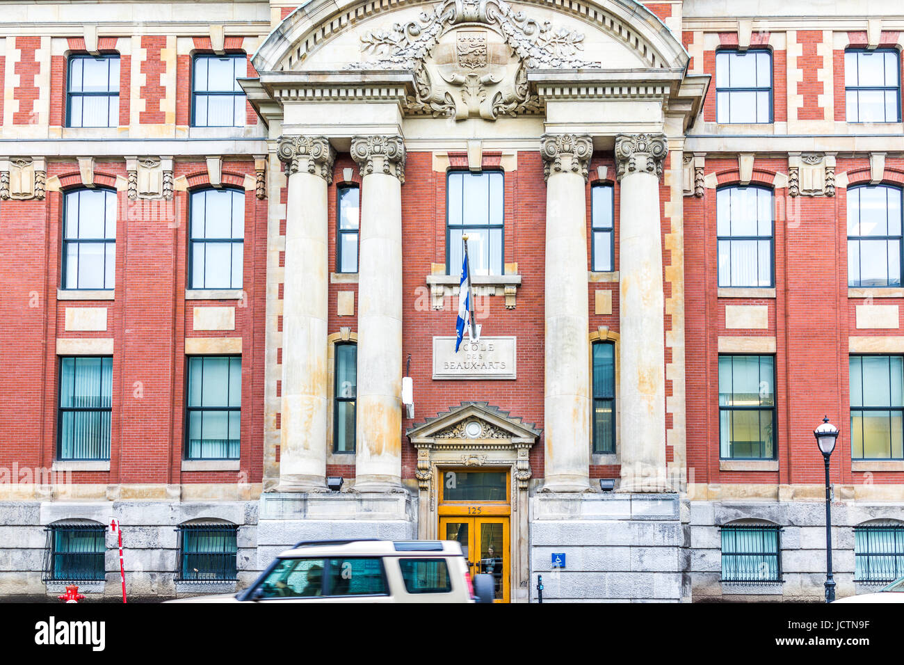 Montreal, Canada - May 26, 2017: Ecole des Beaux-Arts famous art school exterior in city in Quebec region with car Stock Photo