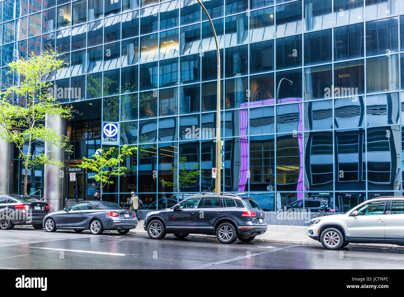 Montreal, Canada - May 26, 2017: Metro station sign in city in Undergound city in Quebec region with modern building - Stock Image