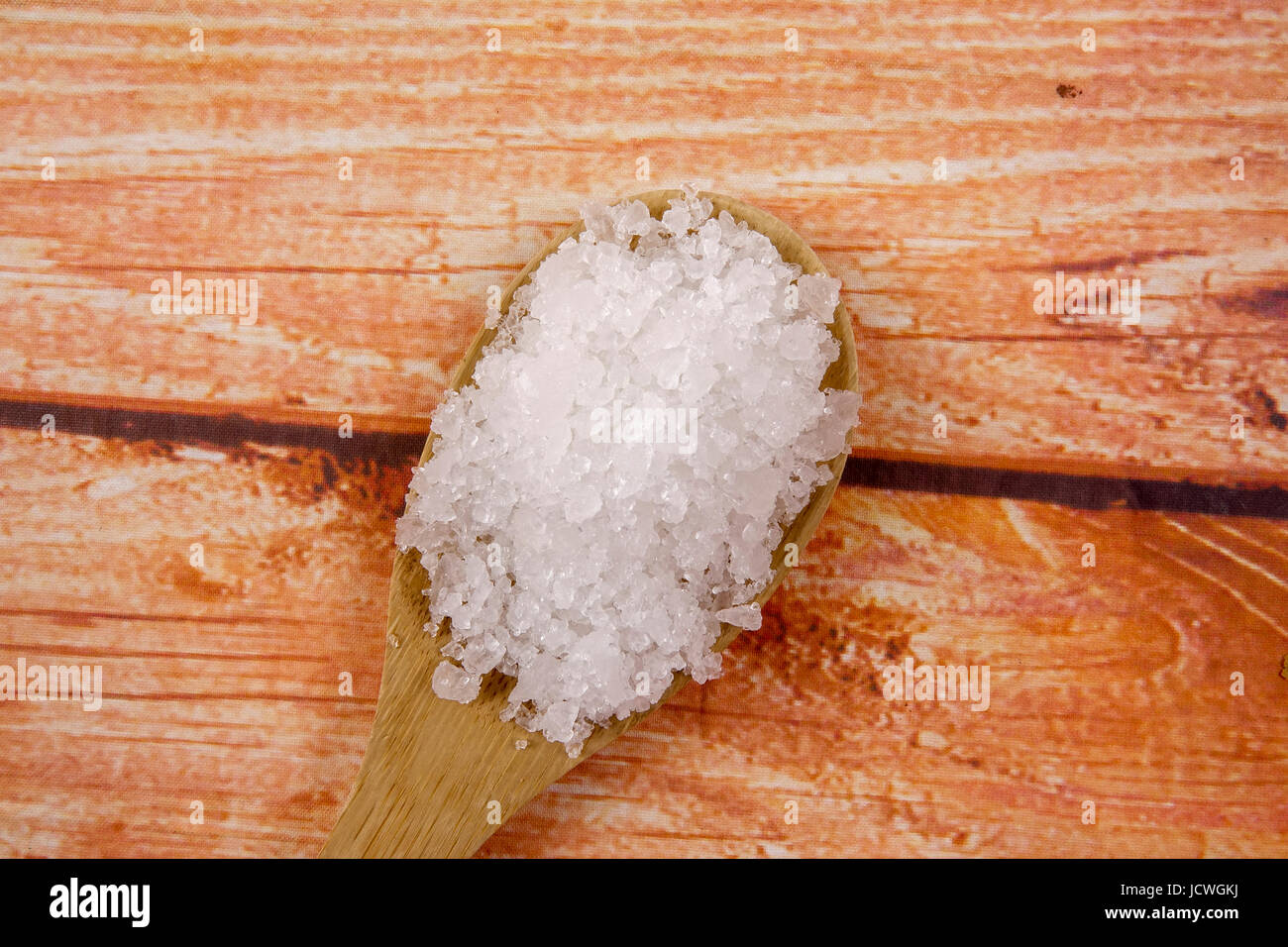 Sea salt in a wooden spoon  Also called bay salt or solar