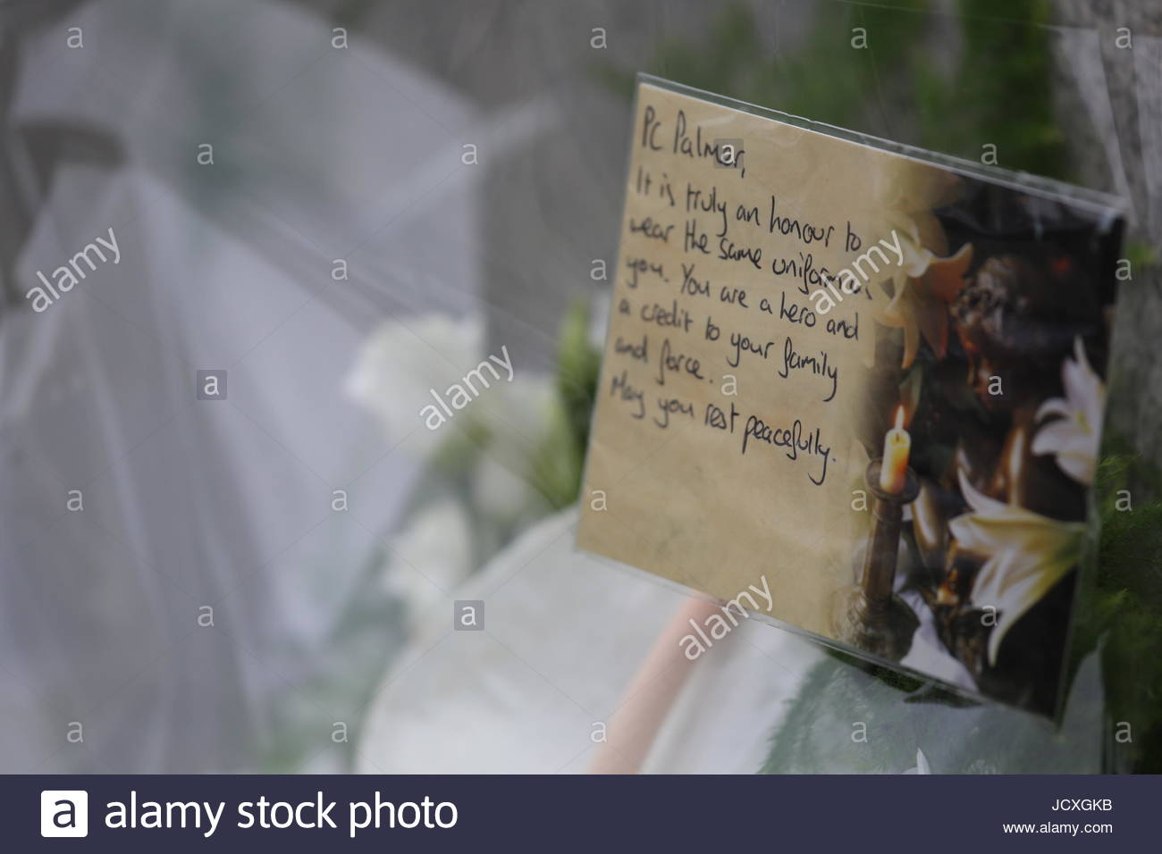 A card on a wreath of flowers remembering PC Keith Palmer who died during the London Bridge attack - Stock Image