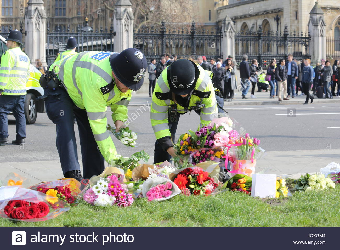 Two police officers lay flowers as part of the tribute to PC Keith Palmer and other victims of the London terror - Stock Image