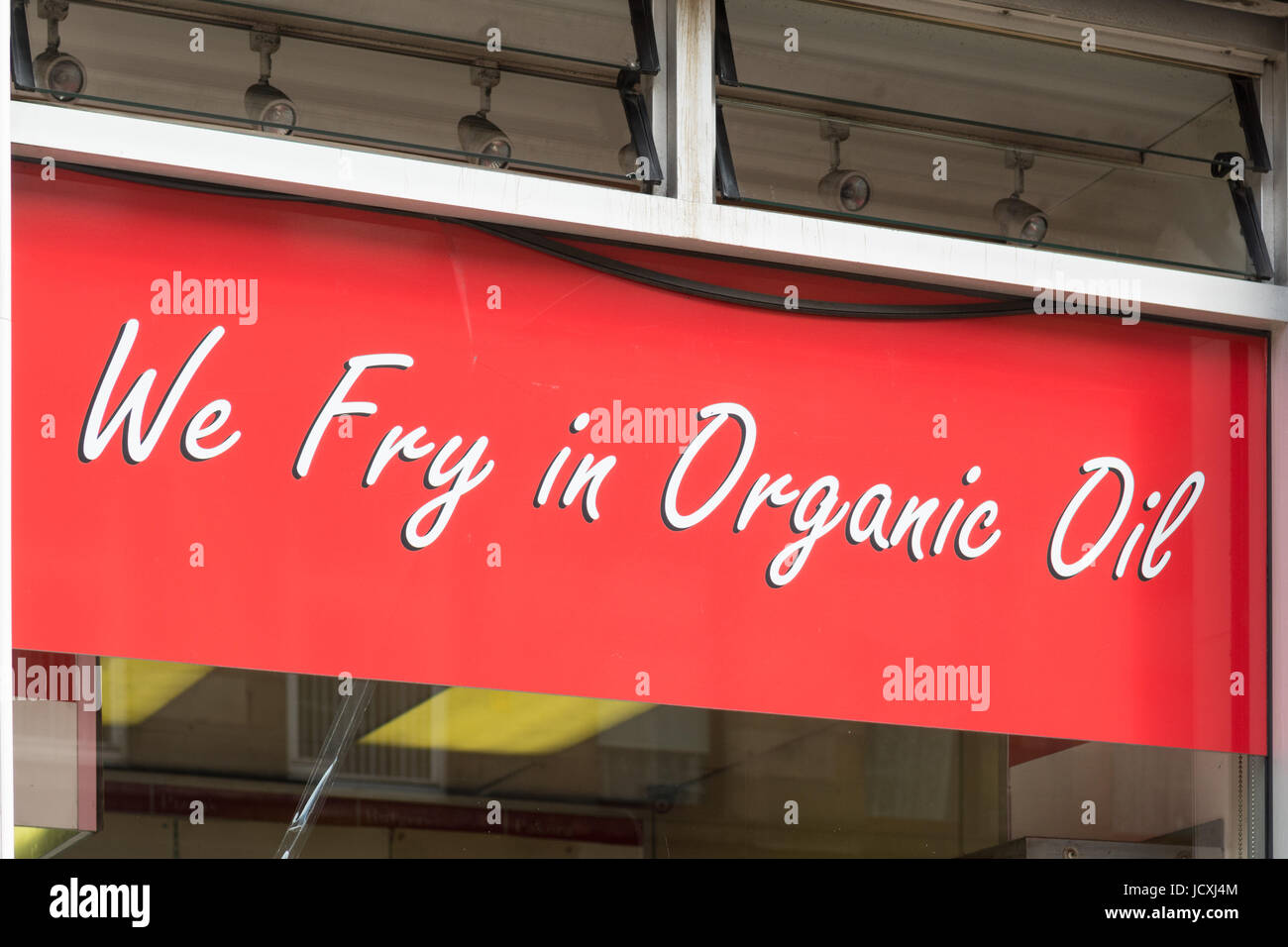 organic oil advertised in fish and chip shop window - The Grove fish and chip shop - Finnieston, Glasgow, Scotland, - Stock Image