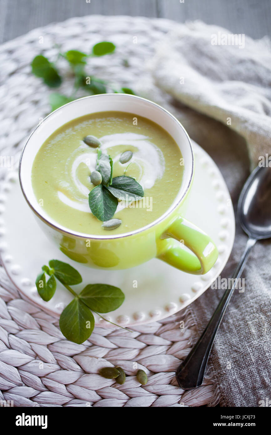 Fresh and healthy green pea soup - Stock Image