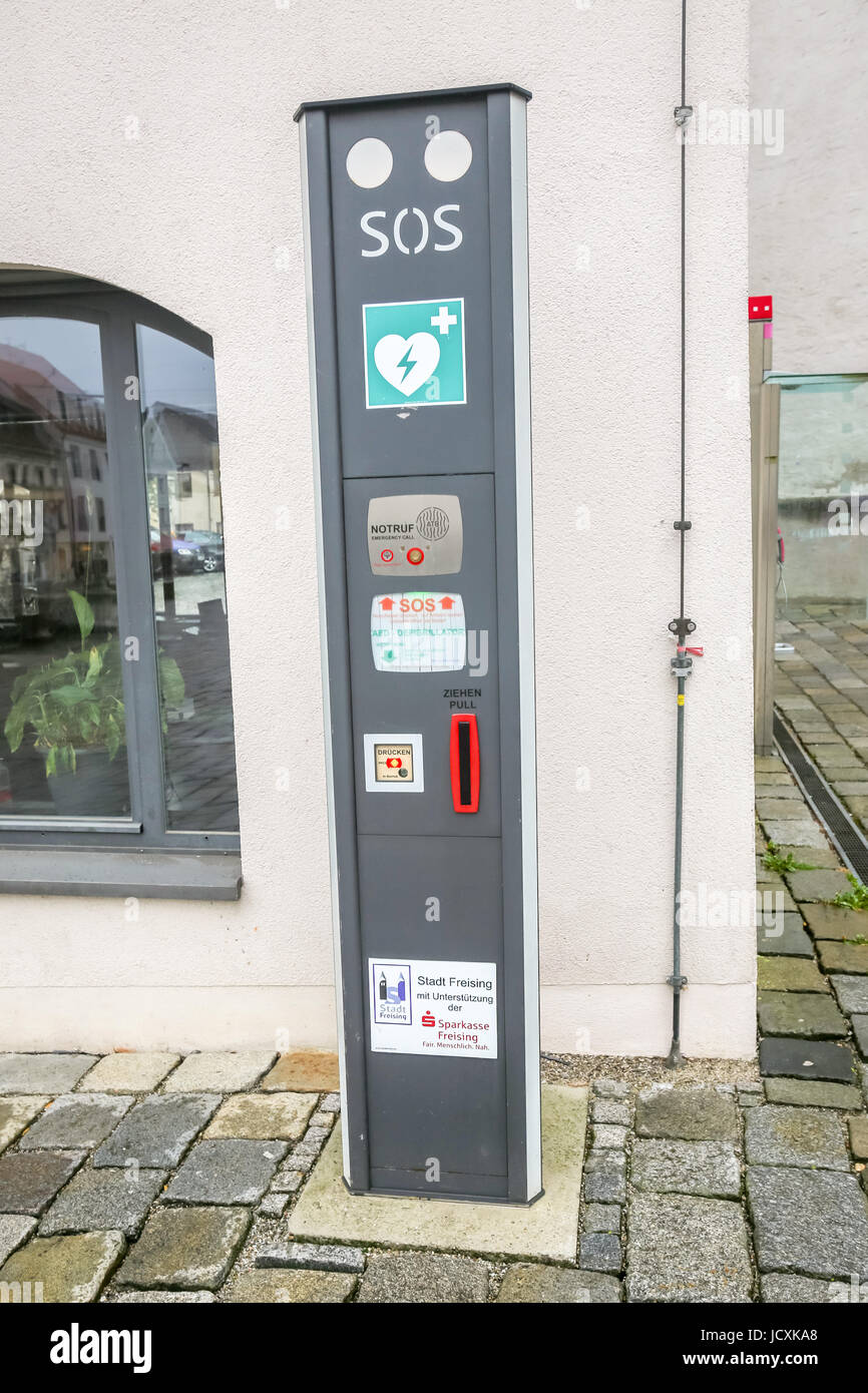 FREISING, GERMANY - MAY 8, 2017 : An SOS defibrillator automat in the street in Freising, Germany. - Stock Image