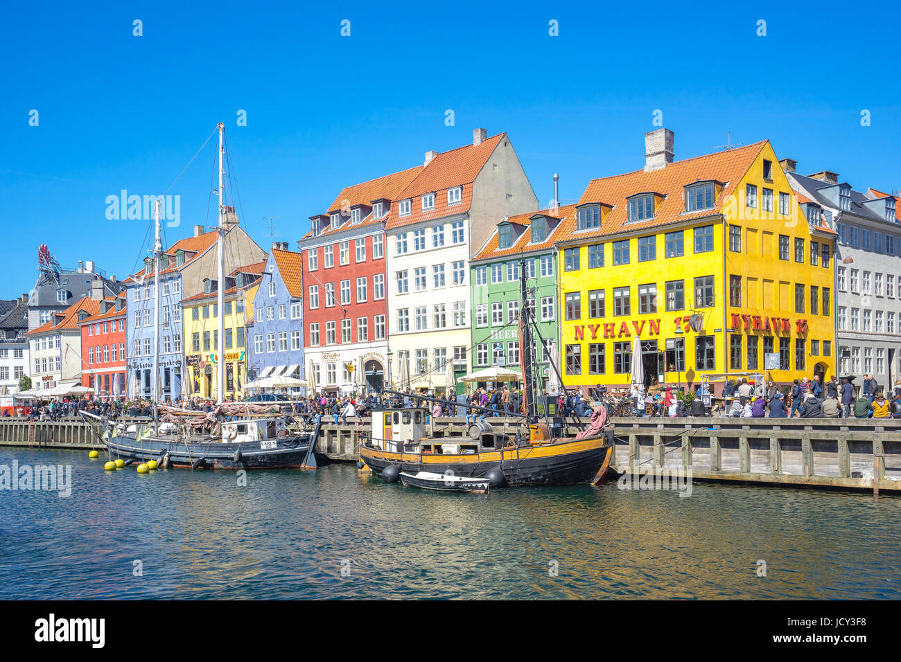Copenhagen, Denmark - May 1, 2017: Nyhavn was originally a busy commercial port where ships from all over the world - Stock Image