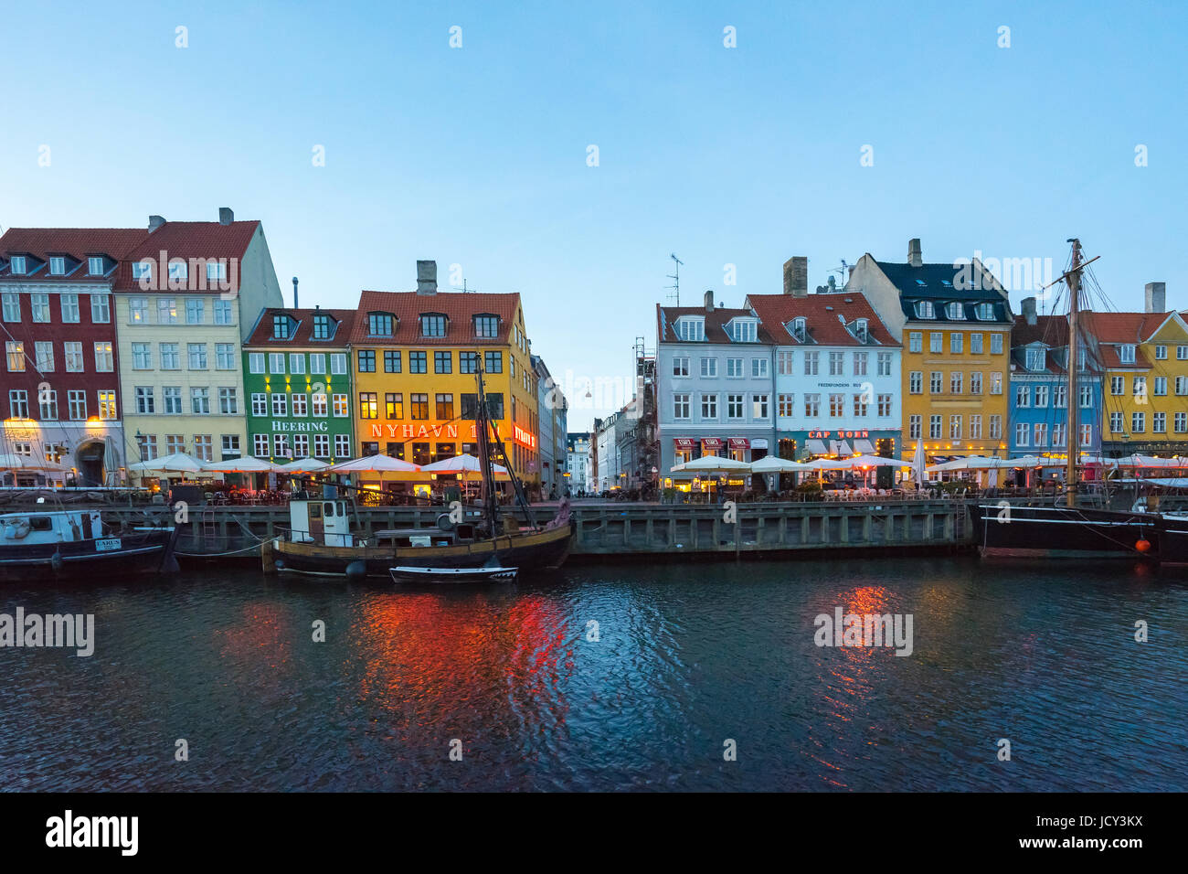 Copenhagen, Denmark - May 1, 2017: Nyhavn is a 17th-century waterfront, canal and entertainment district in Copenhagen, - Stock Image