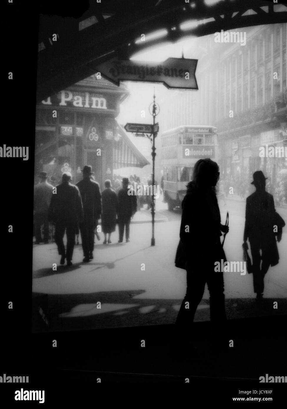 BERLIN GERMANY- BERLIN CITY MUSEUM -  HISTORICAL PICTURE WITH A VISITOR SILHOUETTE  - BERLIN WOMAN - BERLIN HISTORY - Stock Image