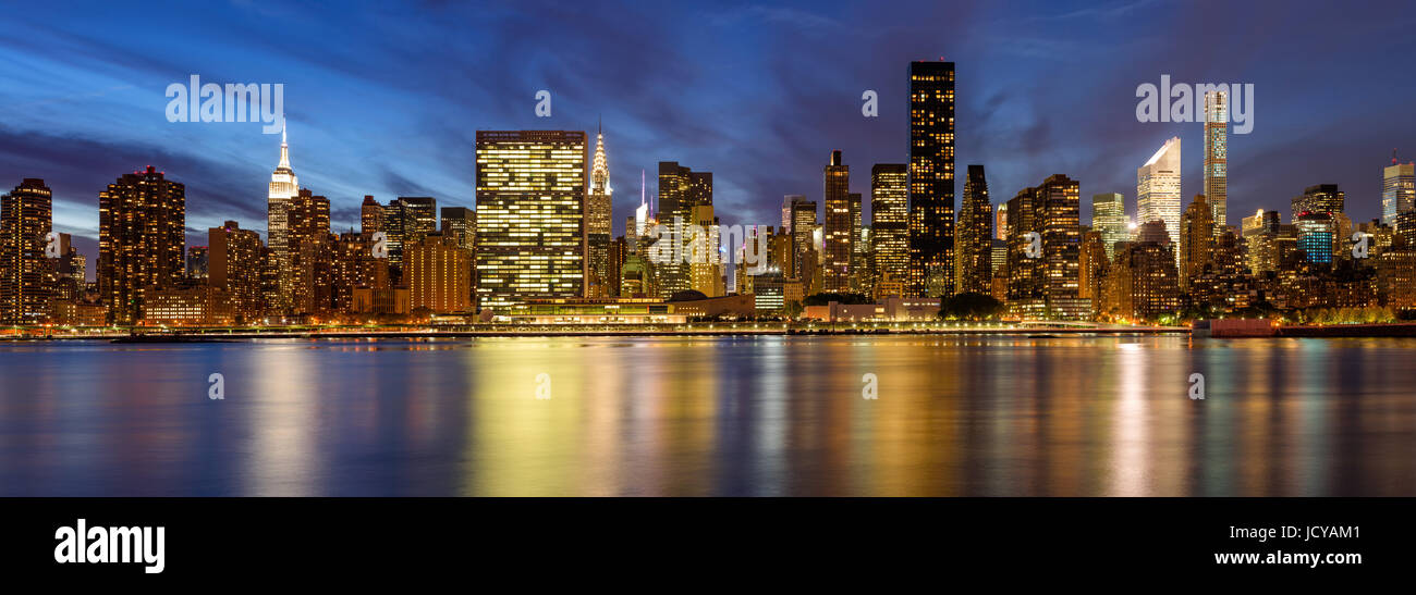 Midtown East skyscrapers from the East River at twilight. New York City - Stock Image