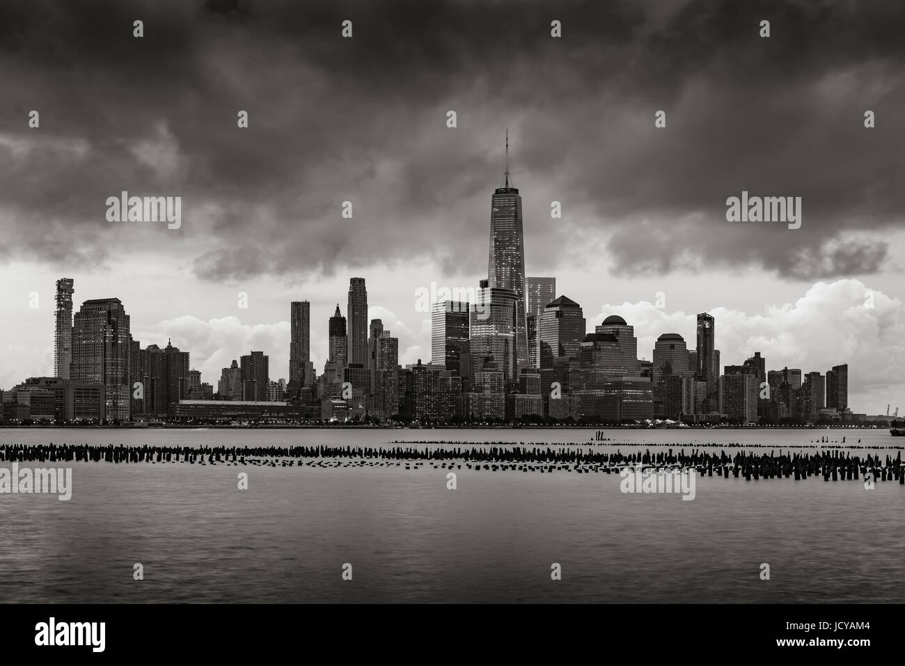 New York City Financial District skyline from across the Hudson River in Black and White. Low storm clouds over Stock Photo