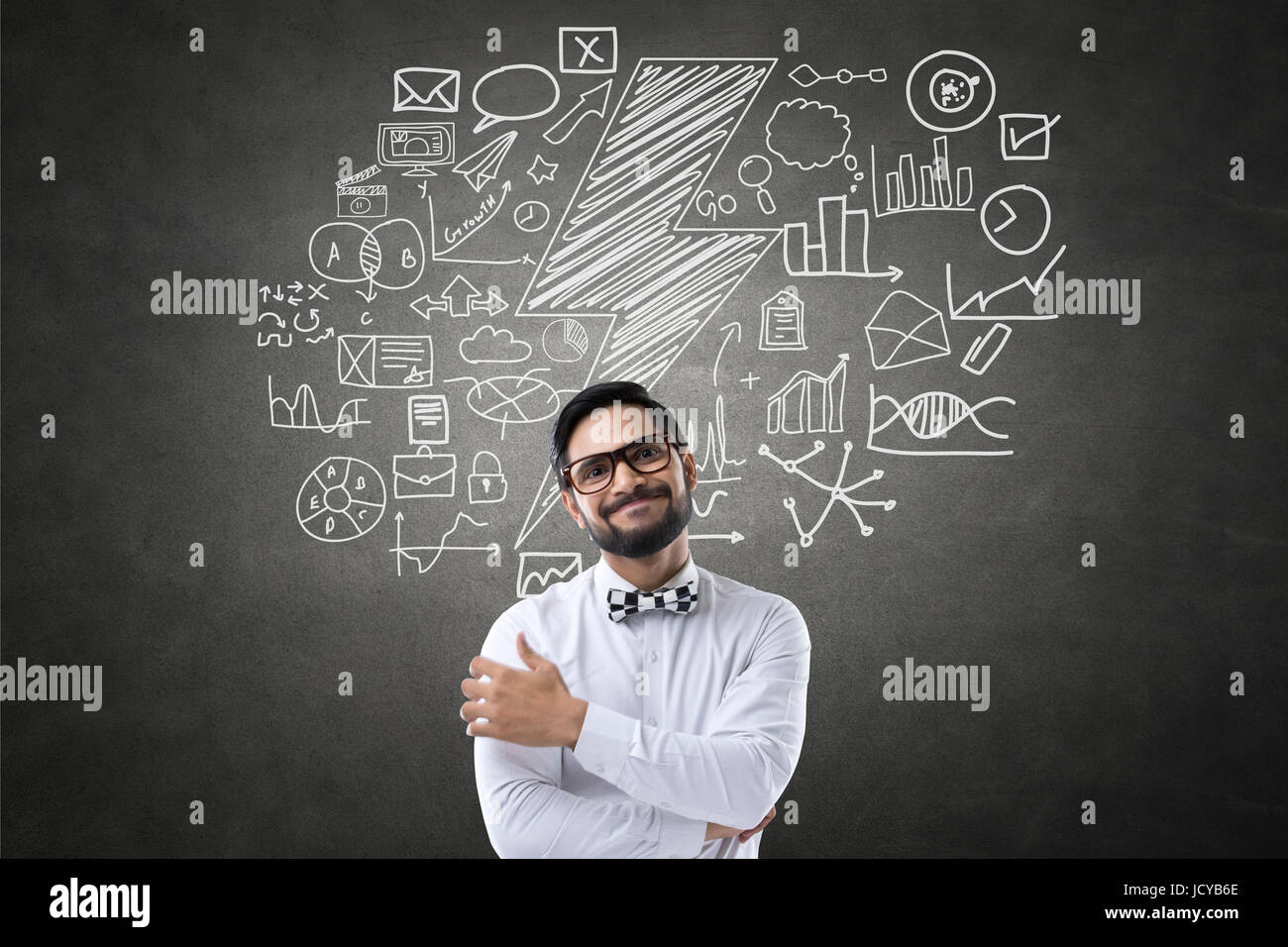 Businessman with lightning and business icons - Stock Image