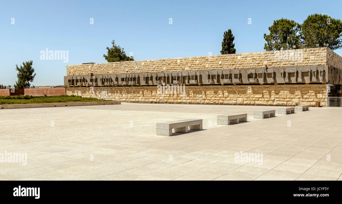 Sculpture in Hebrew signs on a stone wall outside Yad Vashem, the Holocaust Museum, Jerusalem, Israel, Middle East. - Stock Image