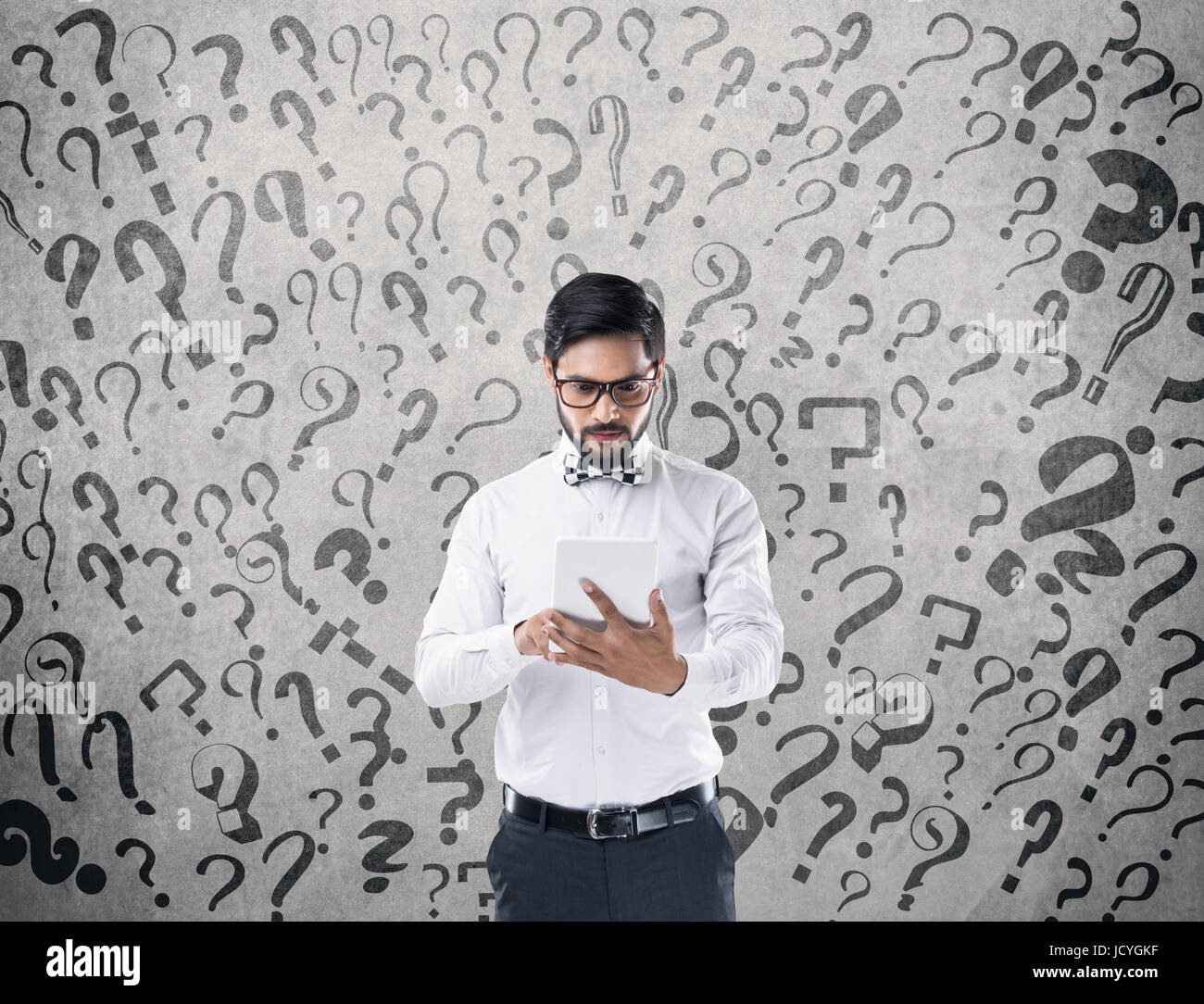 Businessman trying to solve the problems - Stock Image