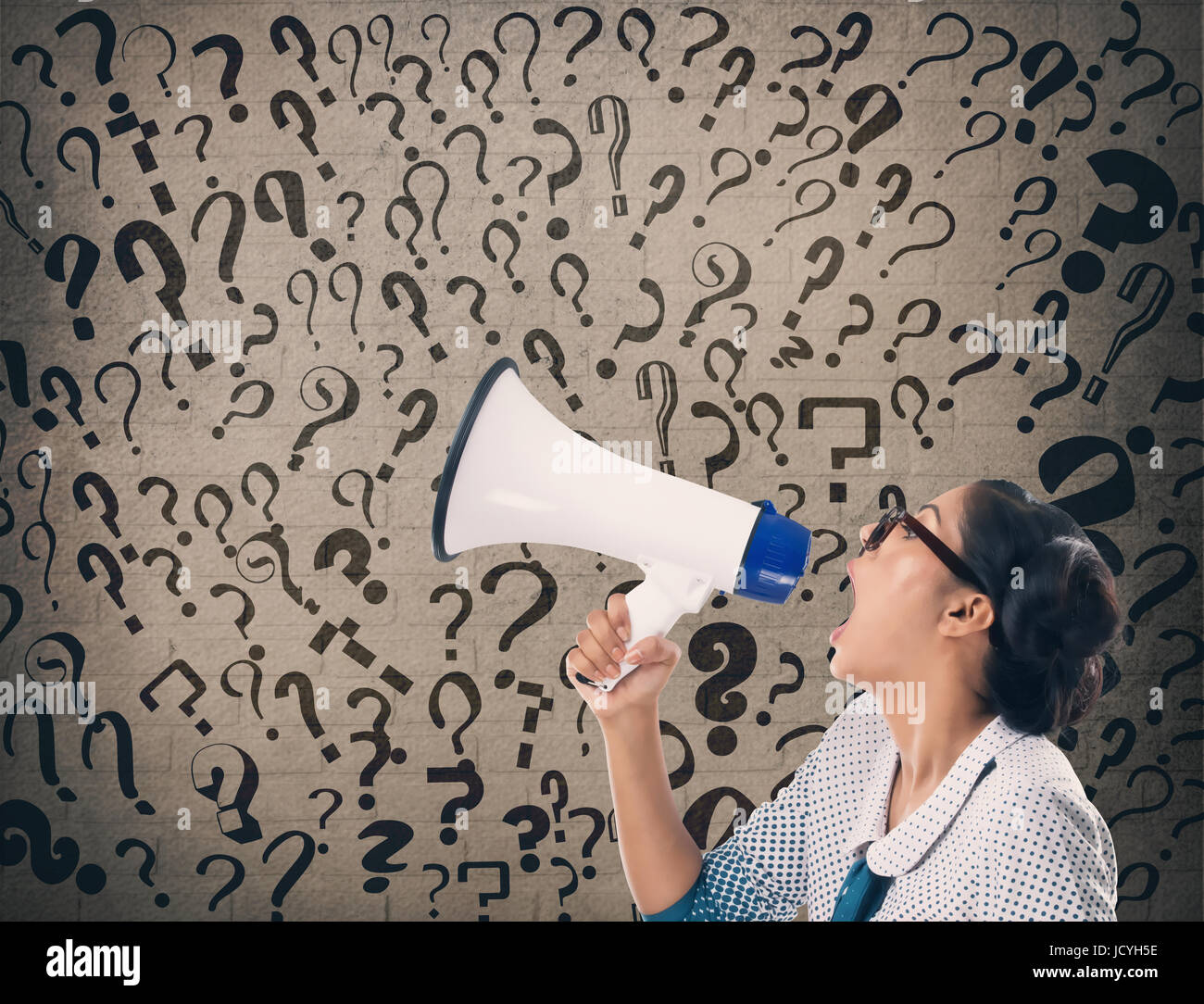 Businesswoman shouting on megaphone - Stock Image