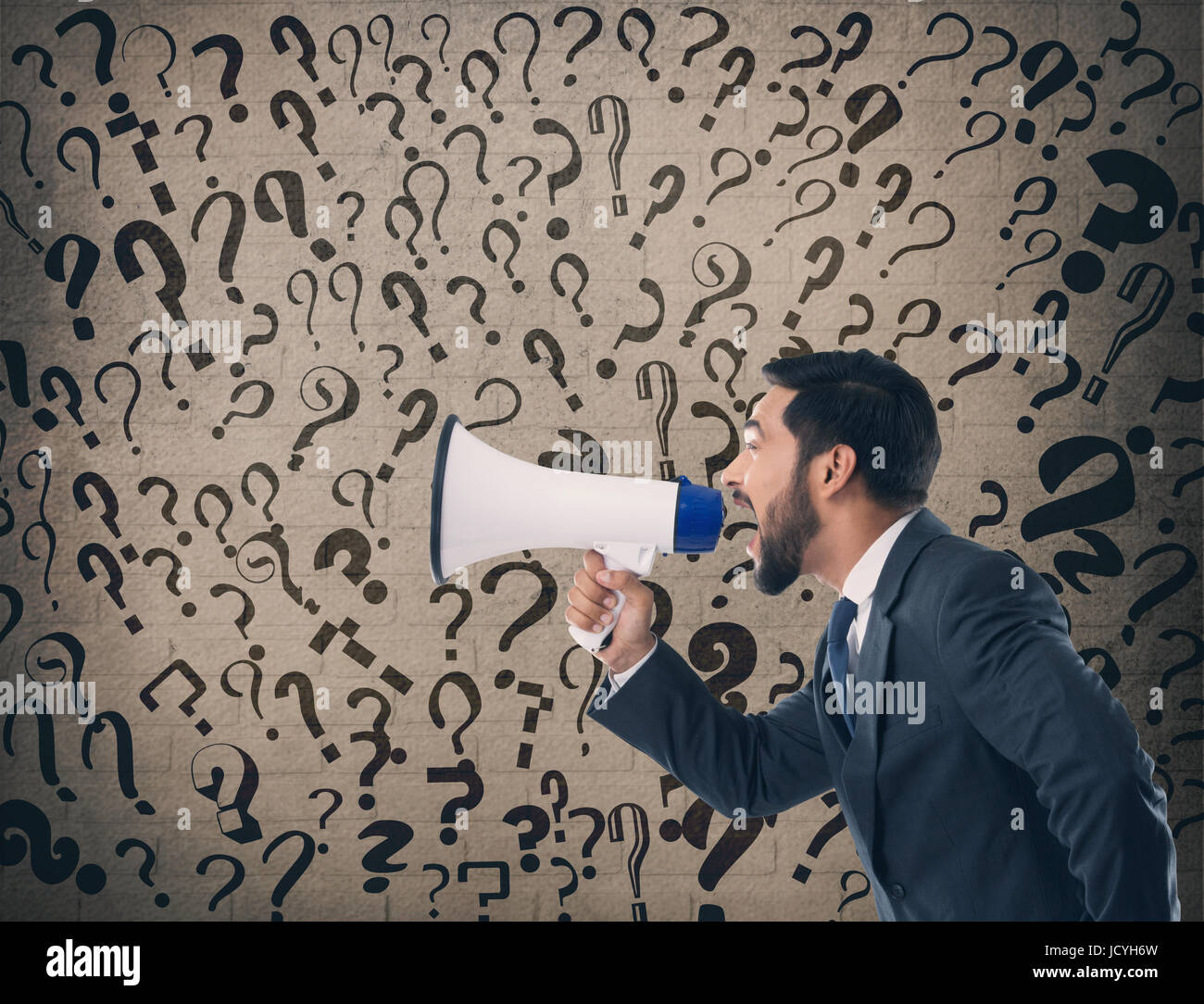 Businessman shouting on megaphone - Stock Image