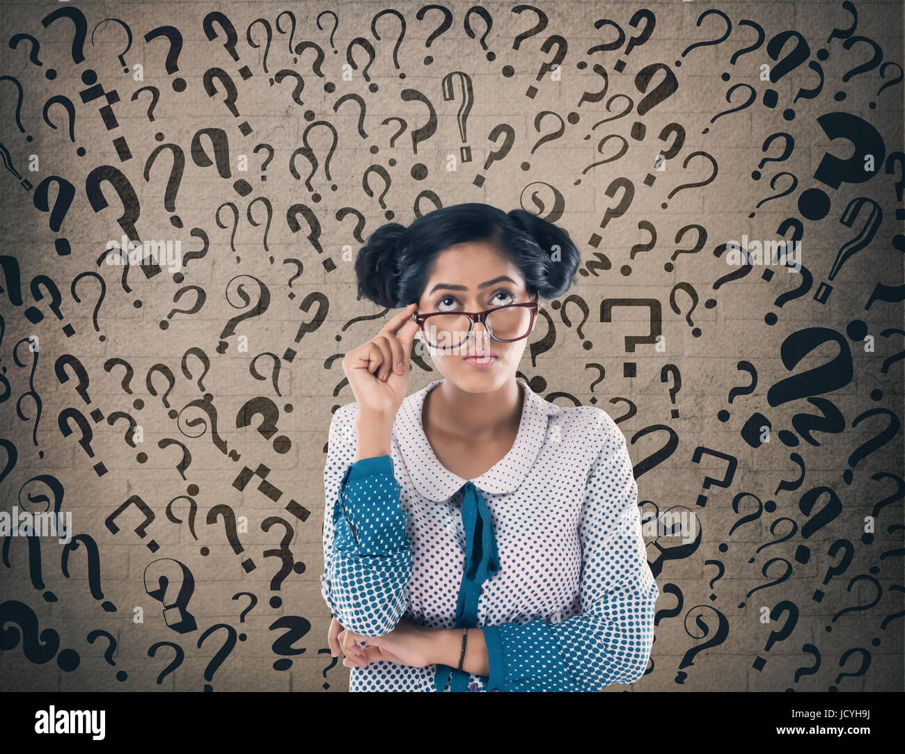 Shocked businessman in front of wall - Stock Image