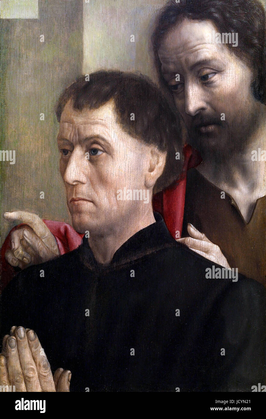 Hugo van der Goes, Portrait of a Man at Prayer with Saint John the Baptist. Circa 1475. Oil on panel. Walters Art - Stock Image