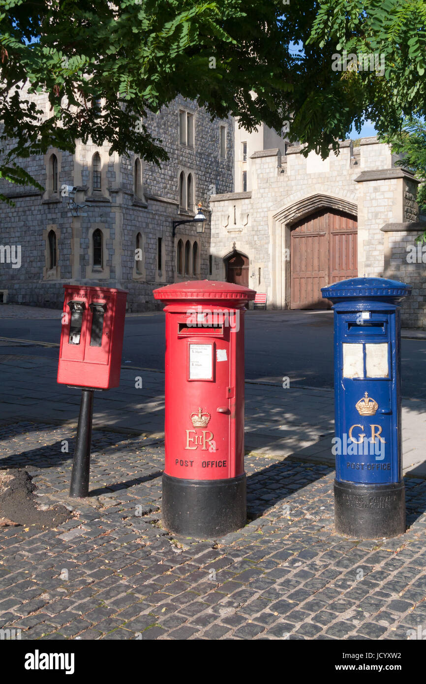 Red and blue postboxes and stamp machine, Windsor, Berkshire, England, United Kingdom - Stock Image