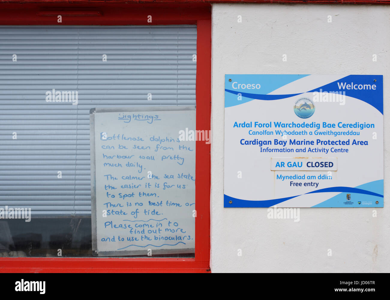 Cardigan bay marine protected area notice on wall and handwritten notice in window new quay wales - Stock Image