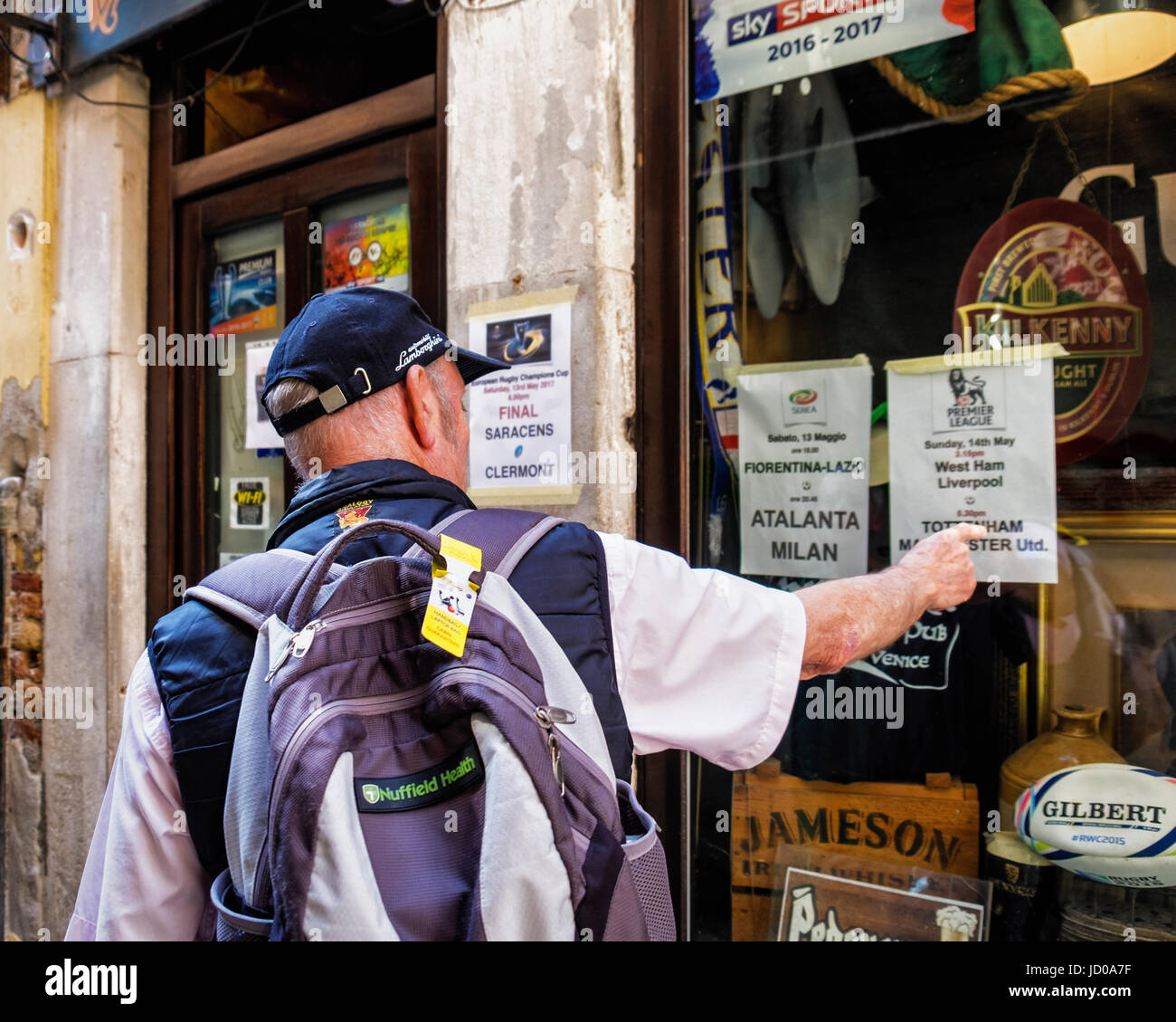 Venice, San Marco.Inishark bar, Senior man finds traditional Irish Pub showing British premier league football games - Stock Image