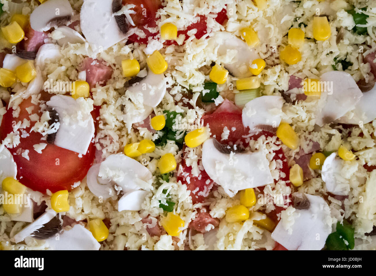 Top view of delicious raw Pizza, macro background. - Stock Image