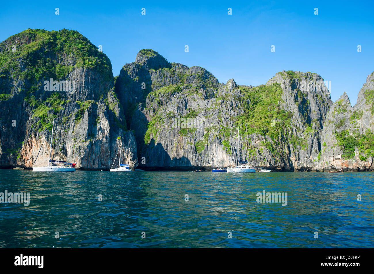 Koh Phi Phi island in Krabi Thailand features distinctive dramatic geography of limestone karst mountains and cliffs Stock Photo