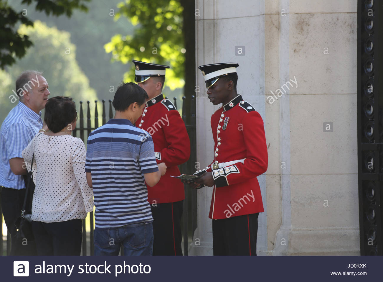 London, UK. 17th June, 2017. Guardsmen of the Coldstream Guards selling programmes to the public. The 2017 Trooping - Stock Image
