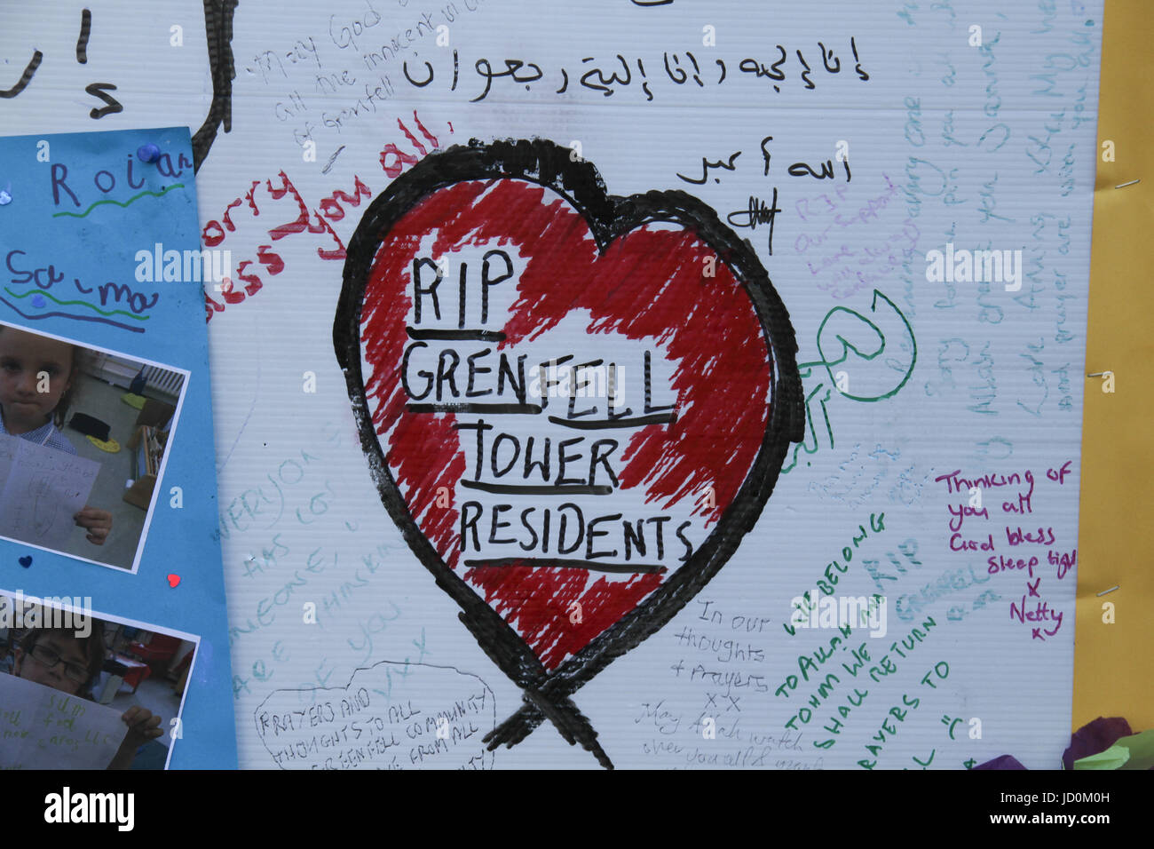 London, UK. 16th June 2017. Messages on a memorial wall in the Latymer area for the Grenfell Tower residents seen - Stock Image