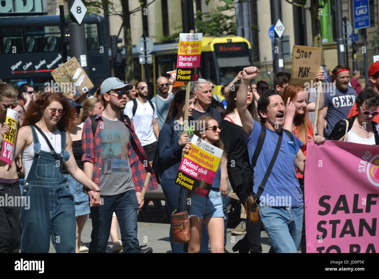 Manchester, UK. 17th June, 2017. Protestors take part in a march against the Tory-DUP government with placards and Stock Photo