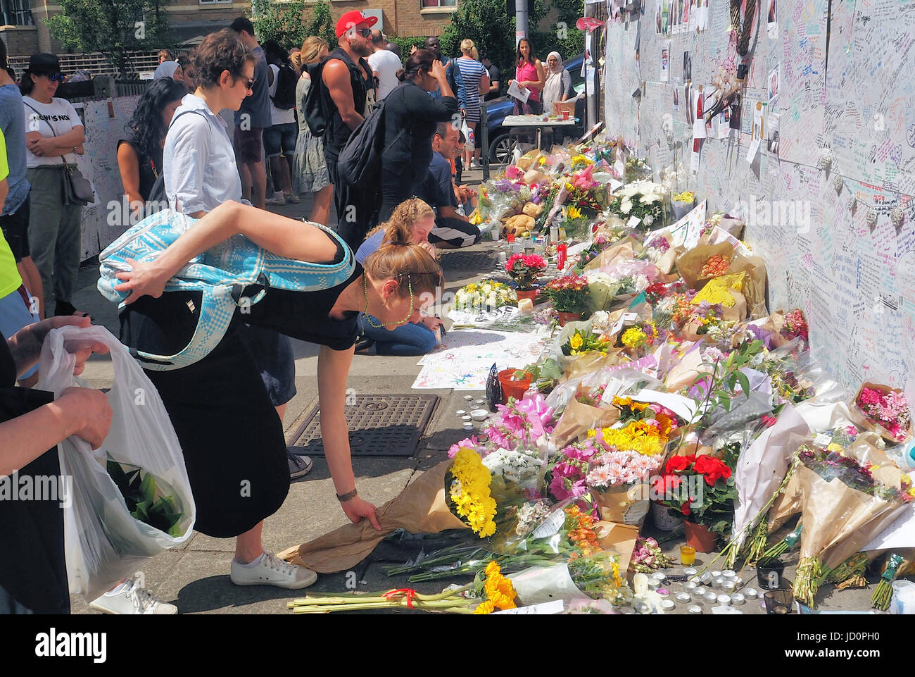 Grenfell Tower Disaster.People lay floral tributes to the Grenfell Fire Disaster - Stock Image