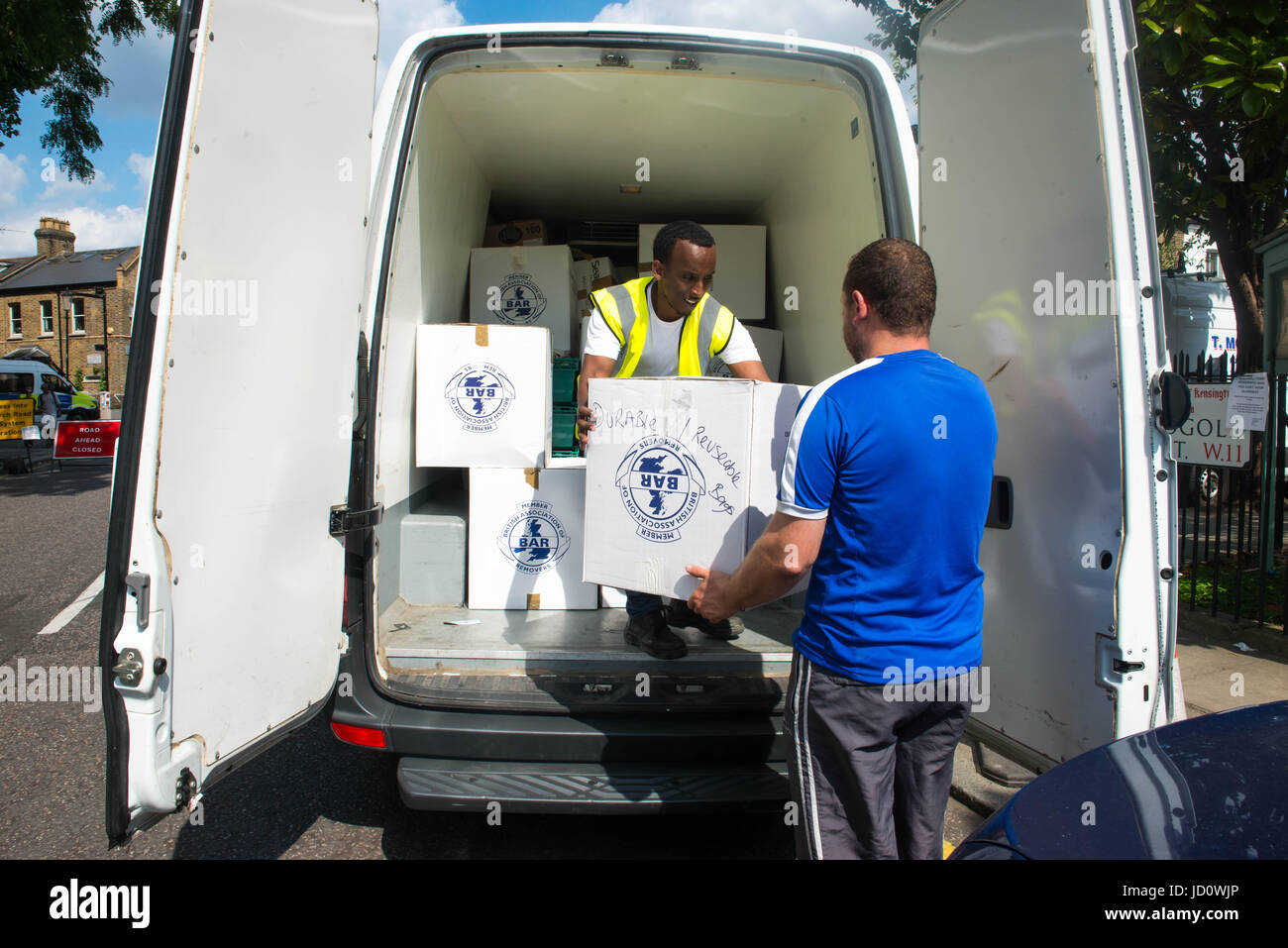 London, United Kingdom. 17th June 2017. Volunteers help distribute items to help those affected by the fire at Grenfell - Stock Image