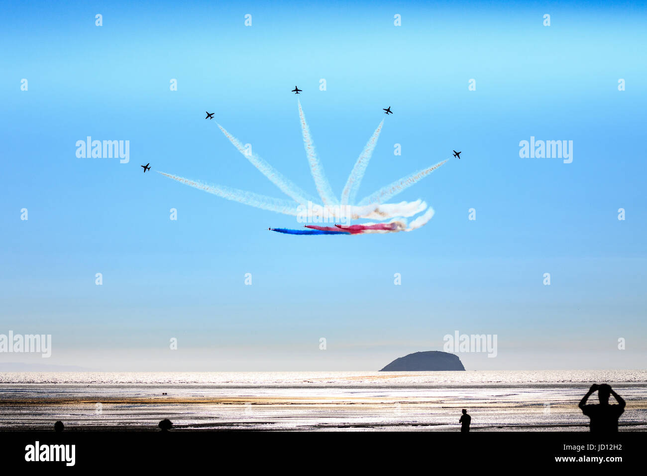 Weston-Super-Mare, England, UK. 17th June, 2017. People watching RAF Red Arrows fan out in formation over Weston Stock Photo