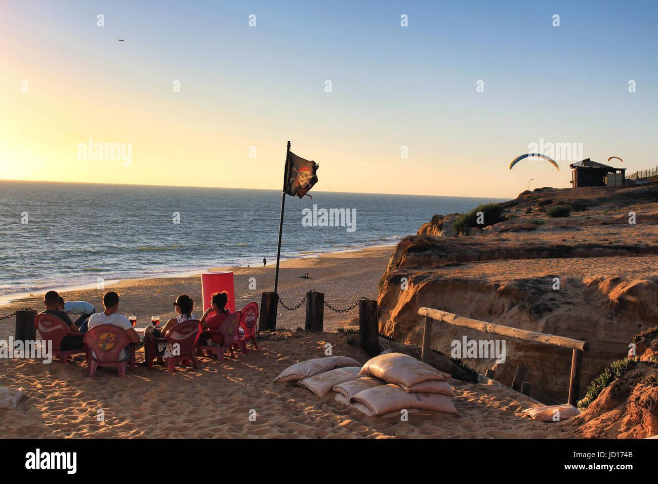 CADIZ/SPAIN - CIRCA OCTOBER 2016: People enjoying the sunset over the Atlantic ocean in a beach bar in Matalascañas - Stock Image