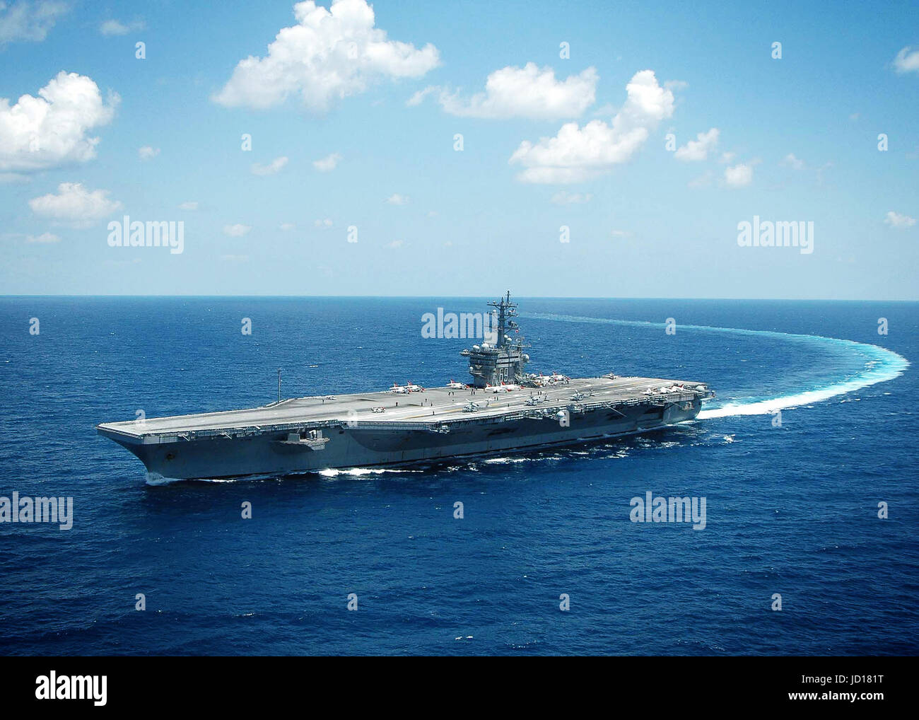 The Nimitz-class aircraft carrier USS Dwight D. Eisenhower (CVN 69) conducts a turn in the Atlantic Ocean. U.S. Stock Photo