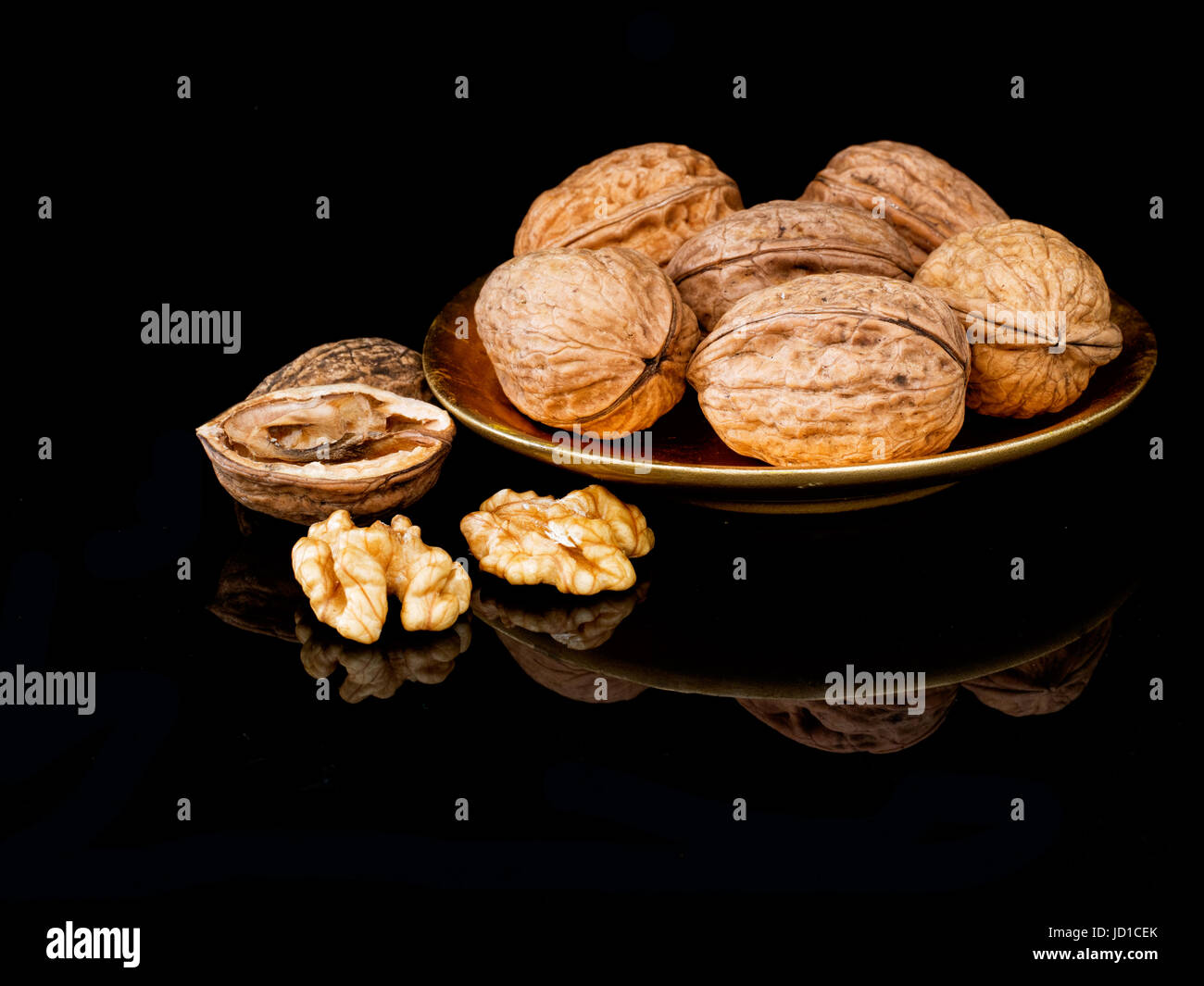Walnuts on plate. Healthy snack. Contain melatonin to aid good sleep plus antioxidants and Omega-3 fatty acids to - Stock Image