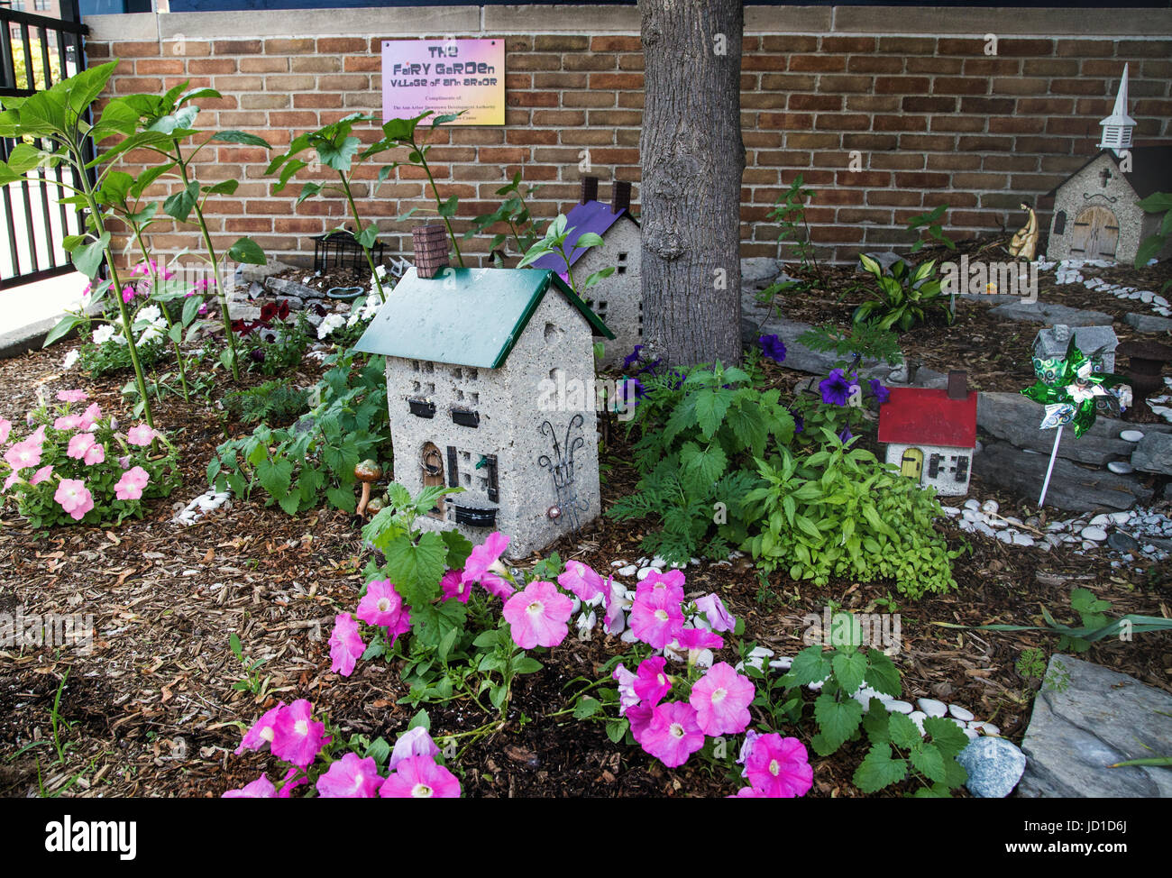 The town of Ann Arbor created a whole fairy village in an unused corner of a parking garage. - Stock Image