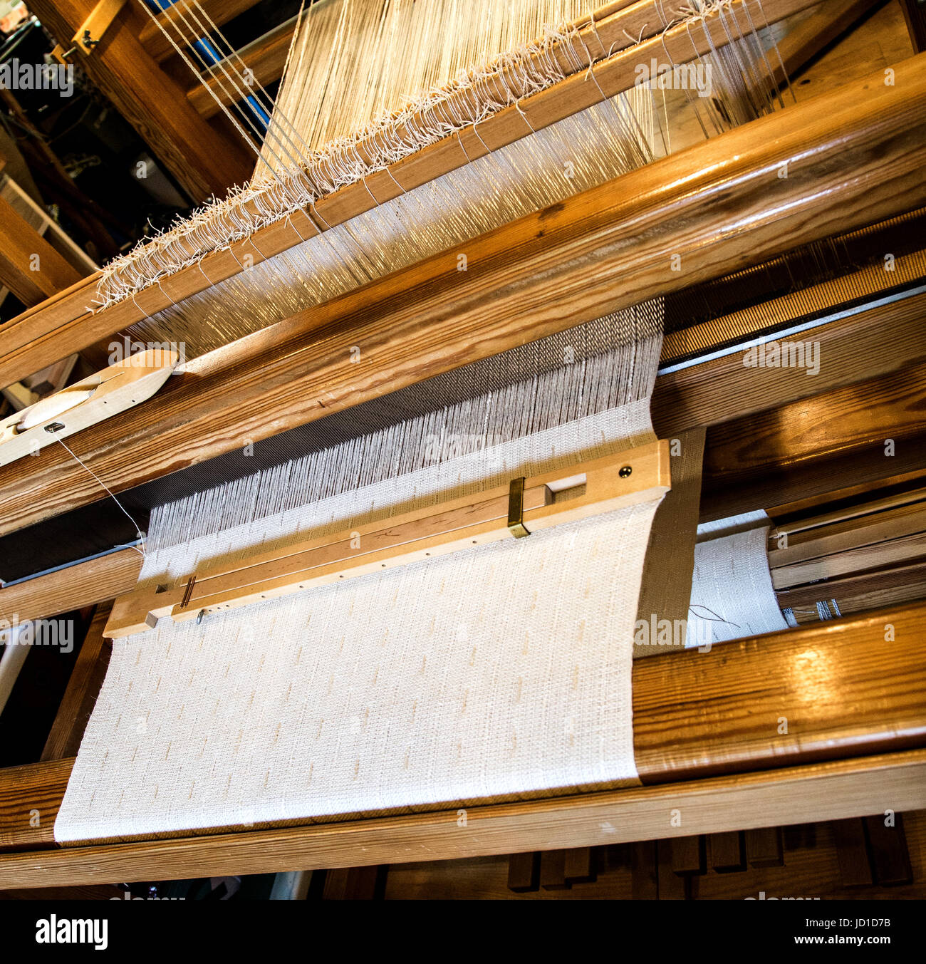 weaving on a loom - Stock Image