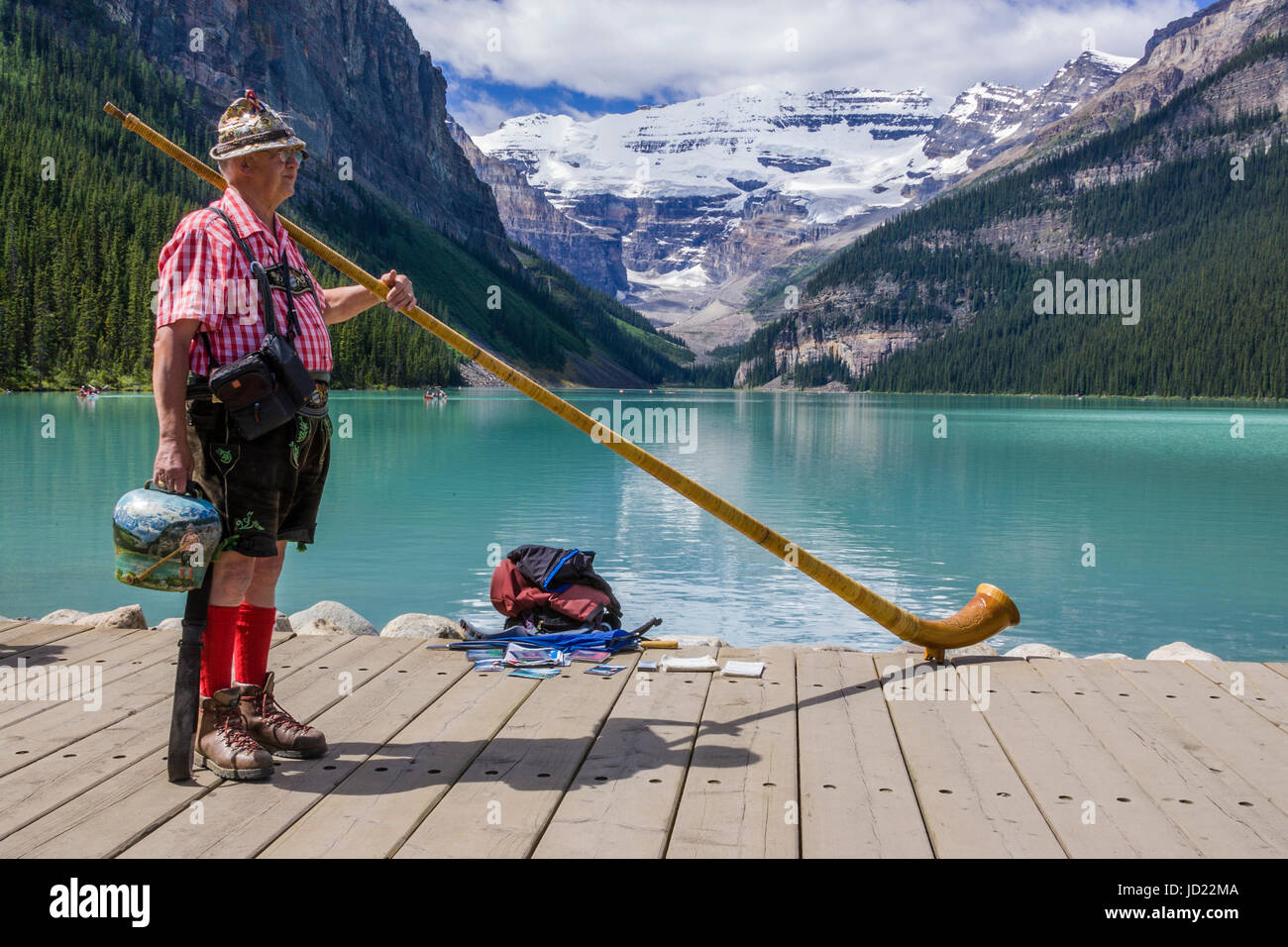 Alp Horn player at Chateau Lake Louise in Banff National Park, Alberta, Canada. - Stock Image