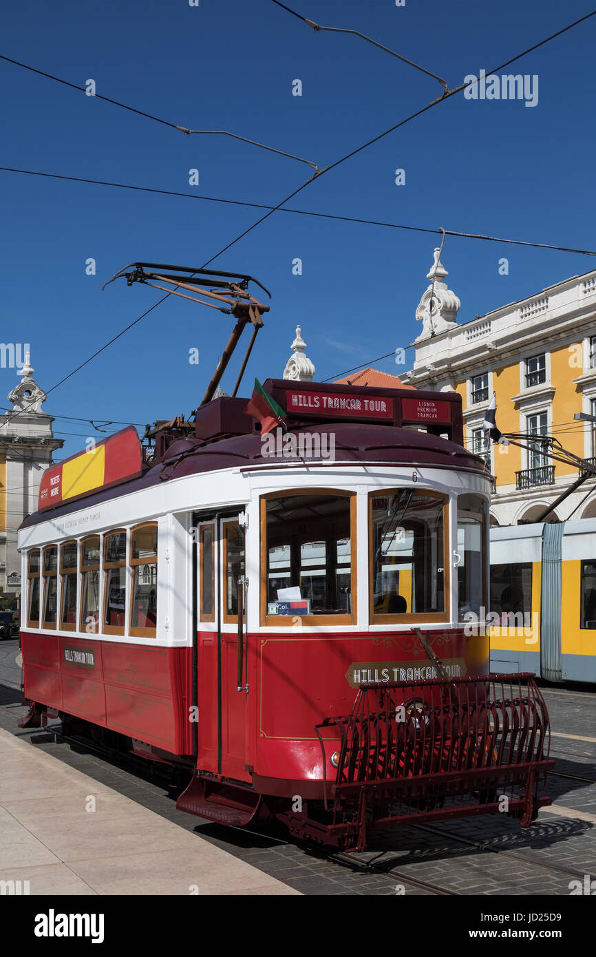 Lisbon - Portugal.  Hills Tramcar used for historic city tours in Lisbon city centre. At a tram stop in Praca do - Stock Image