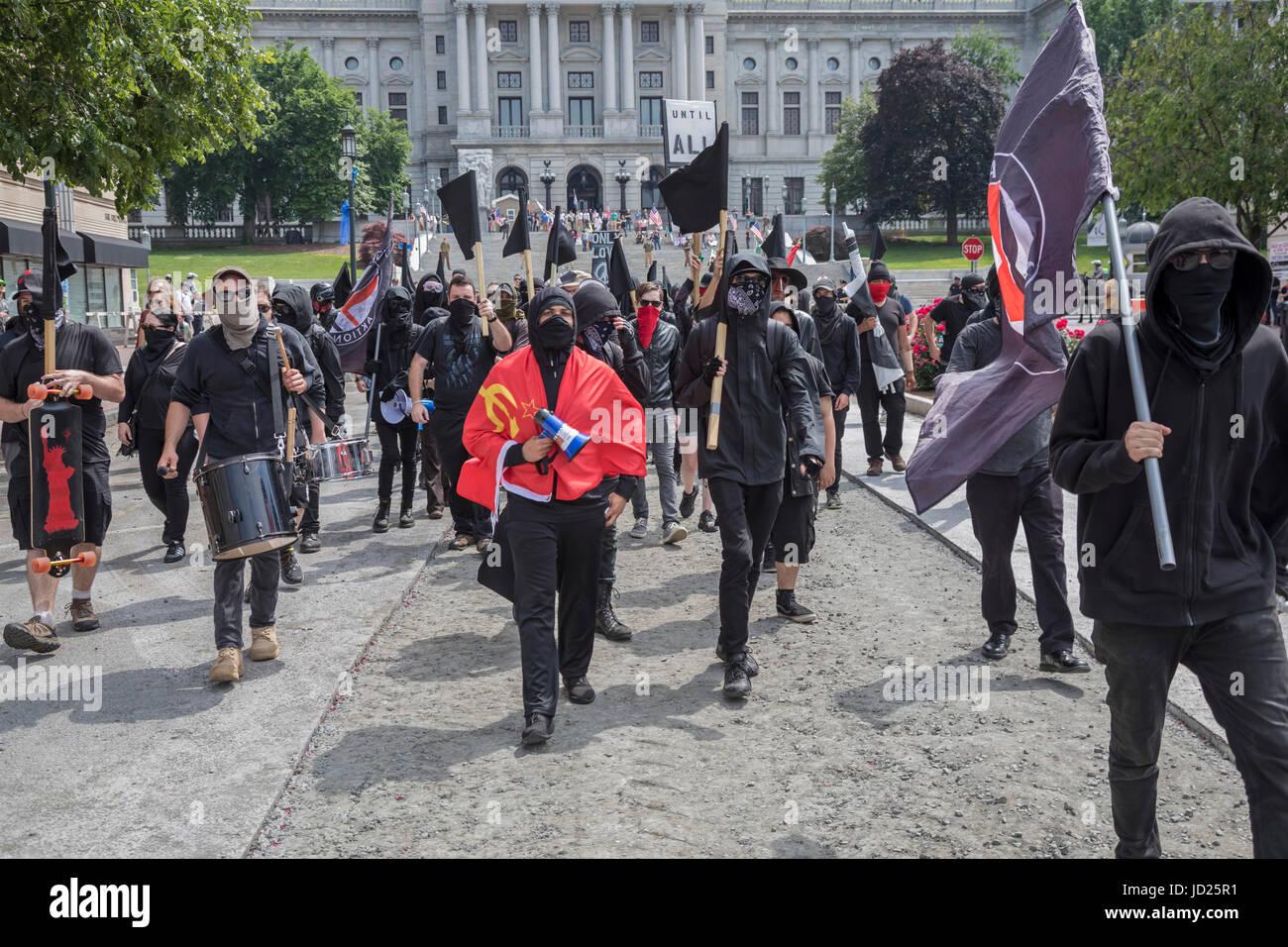 Harrisburg, Pennsylvania - Black Bloc anarchists counter-demonstrate against an anti-Muslim, anti-sharia rally organized - Stock Image