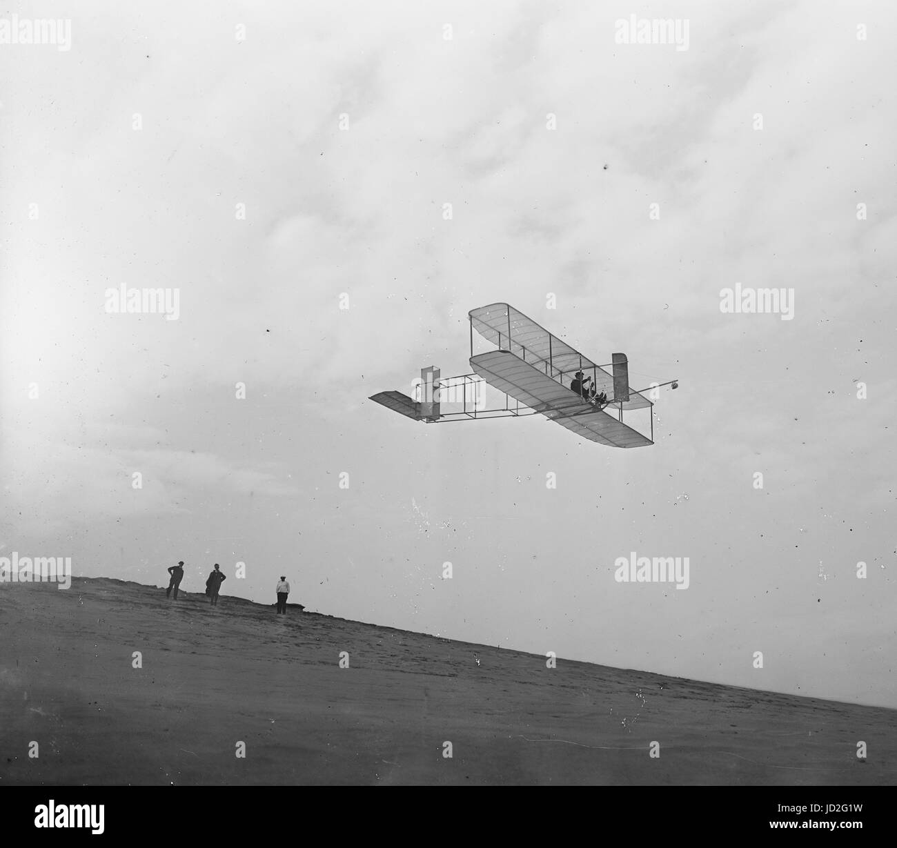 Right front view of Wright Brothers glider in flight. - Stock Image