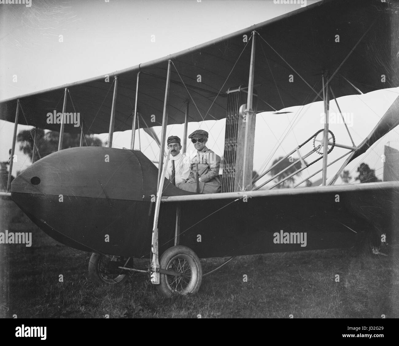 Katharine Wright, wearing a leather jacket, cap, and goggles, aboard the Wright Model HS airplane with Orville, - Stock Image
