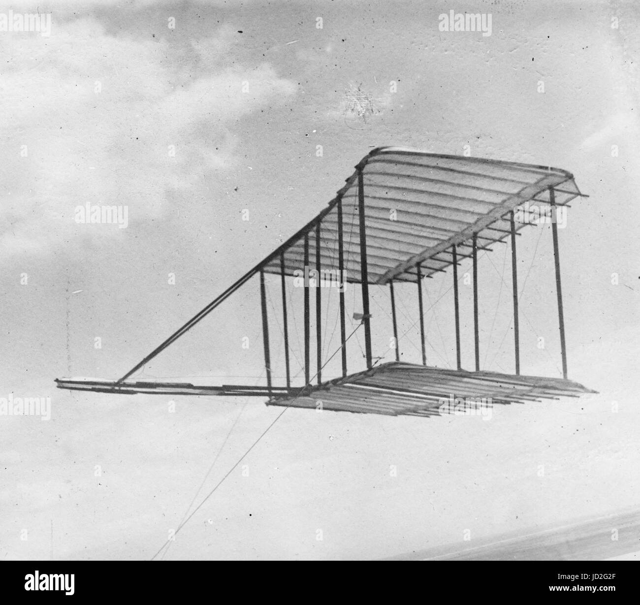 Left side view of glider flying as a kite, in level flight, Kitty Hawk, North Carolina. - Stock Image