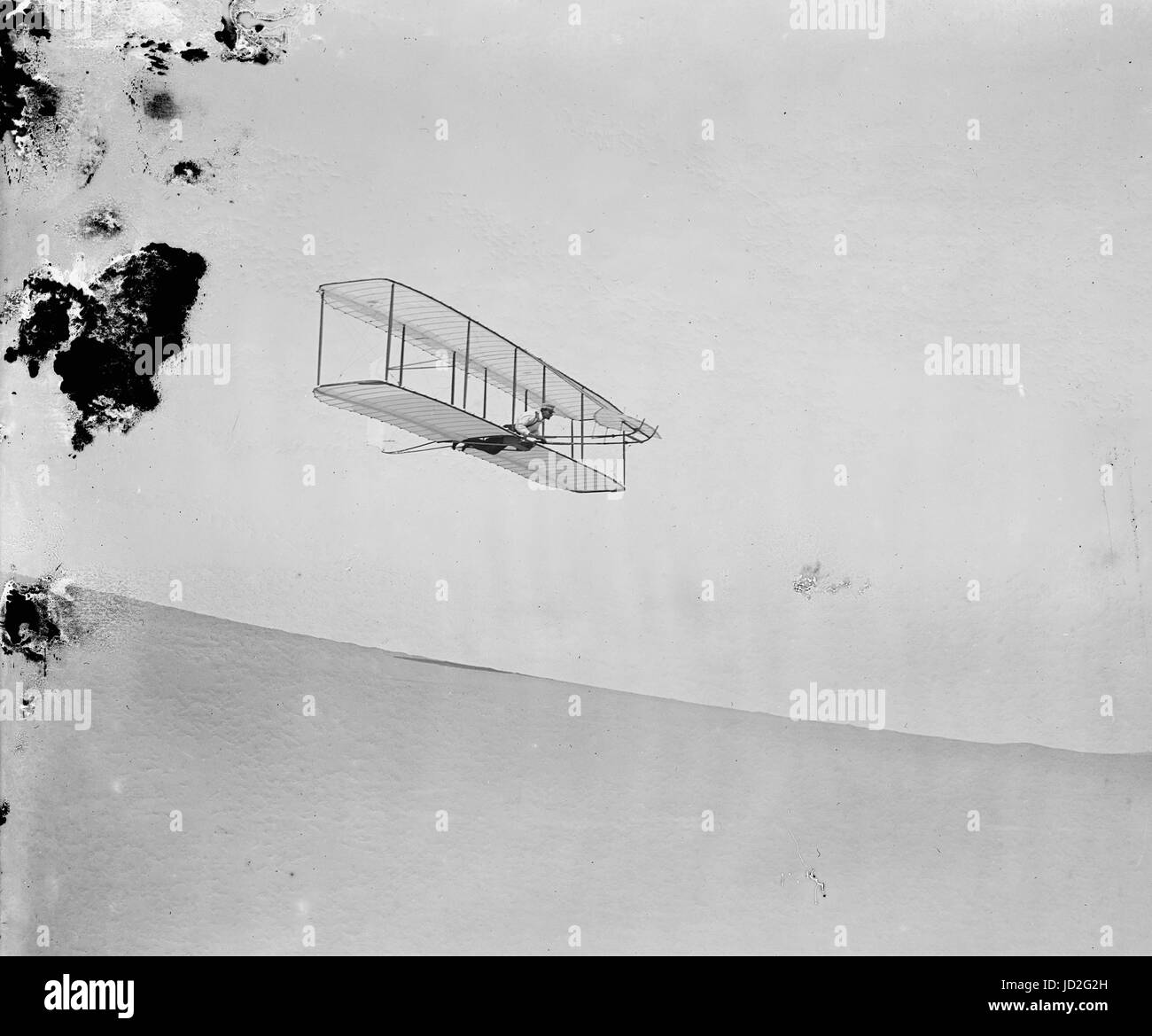 Wilbur gliding down steep slope of Big Kill Devil Hill; Kitty Hawk, North Carolina. - Stock Image