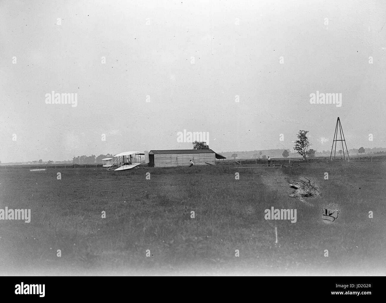 Start of the first flight of 1905, Orville Wright at controls of the machine, near the hangar at Huffman Prairie. - Stock Image