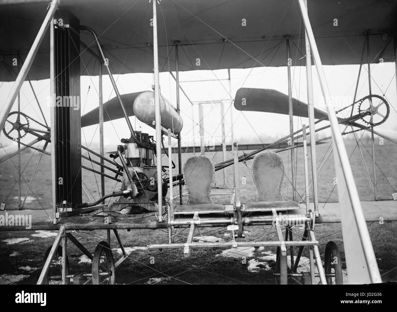 Close-up view of airplane, including the pilot and passenger seats. - Stock Image