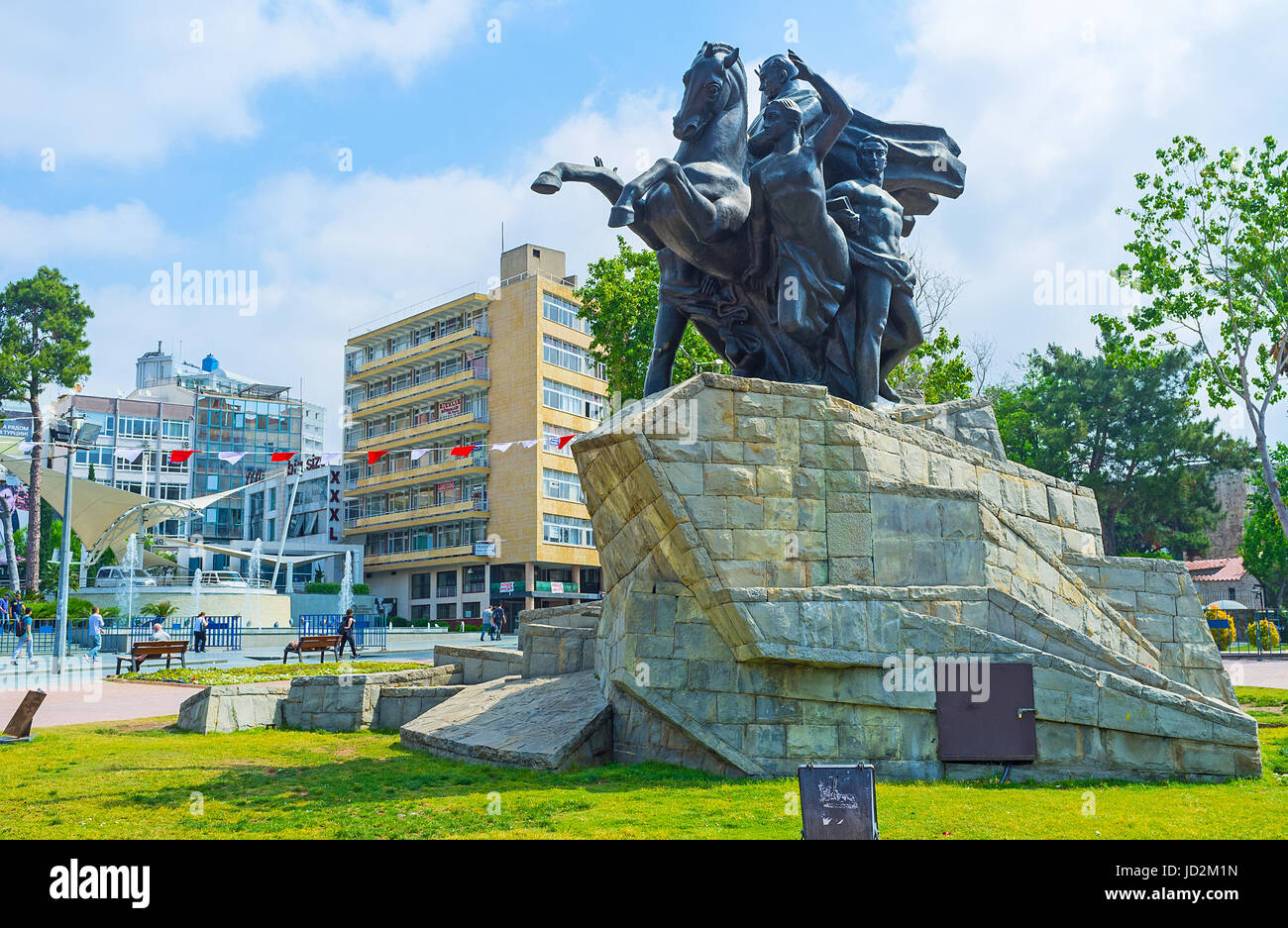 ANTALYA, TURKEY - MAY 6, 2017: The equestrian statue of Ataturk in Republic Square, surrounded by modern hotels - Stock Image